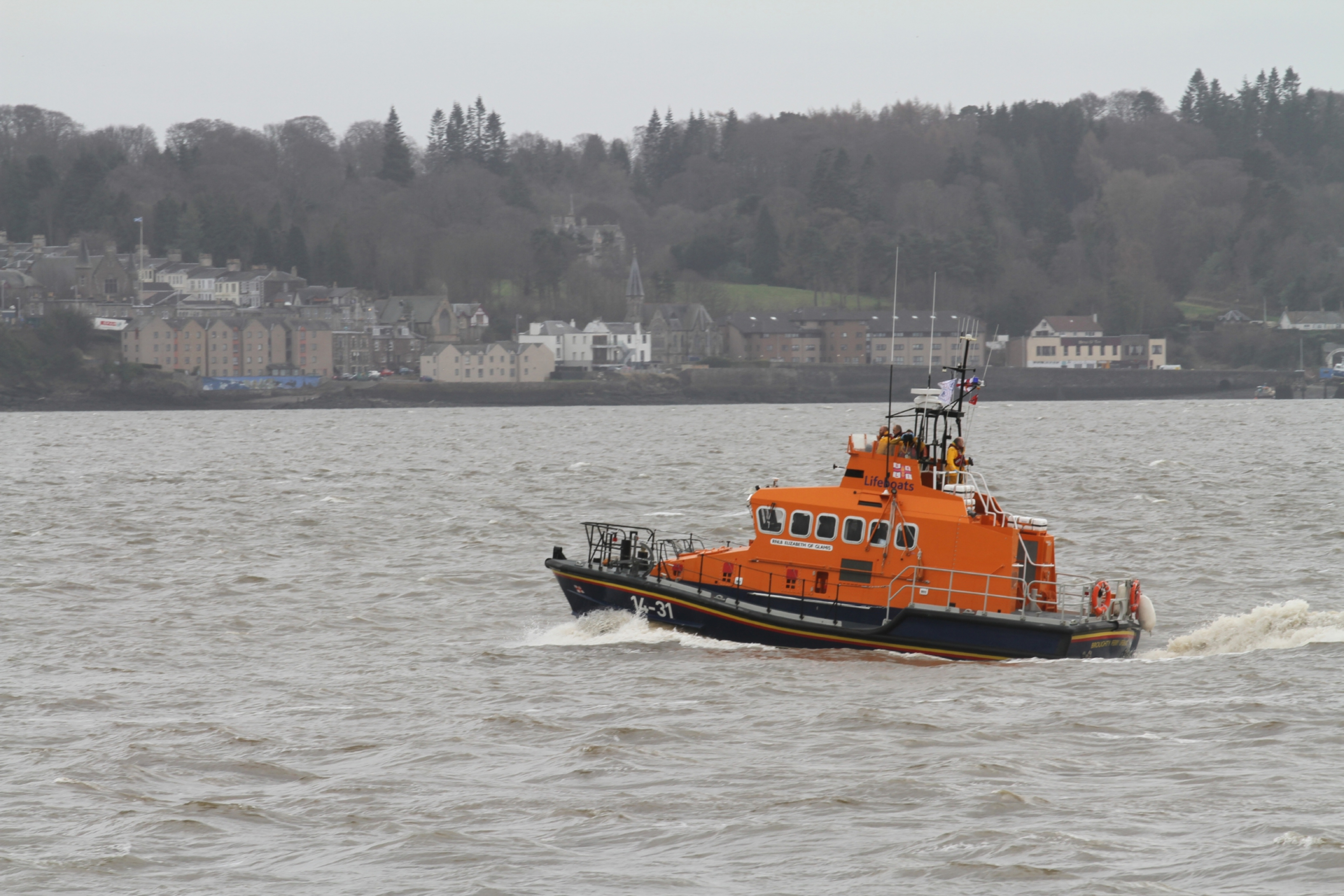 A lifeboat searches the river today