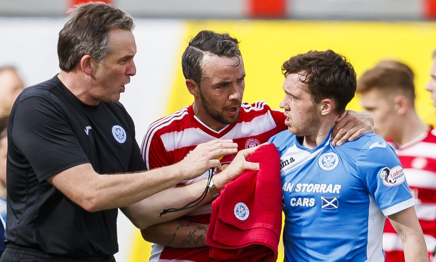 Danny Swanson is calmed down after the incident at New Douglas Park