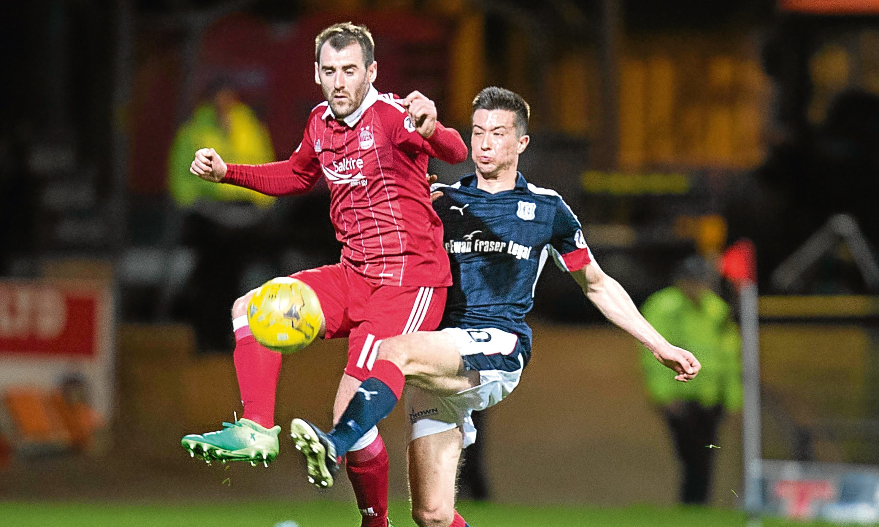 Cammy Kerr challenges Niall McGinn during Friday night's game at Dens Park