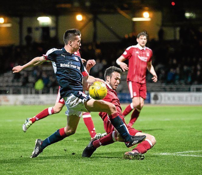 Cammy Kerr tries to get in a cross against Aberdeen at Dens.