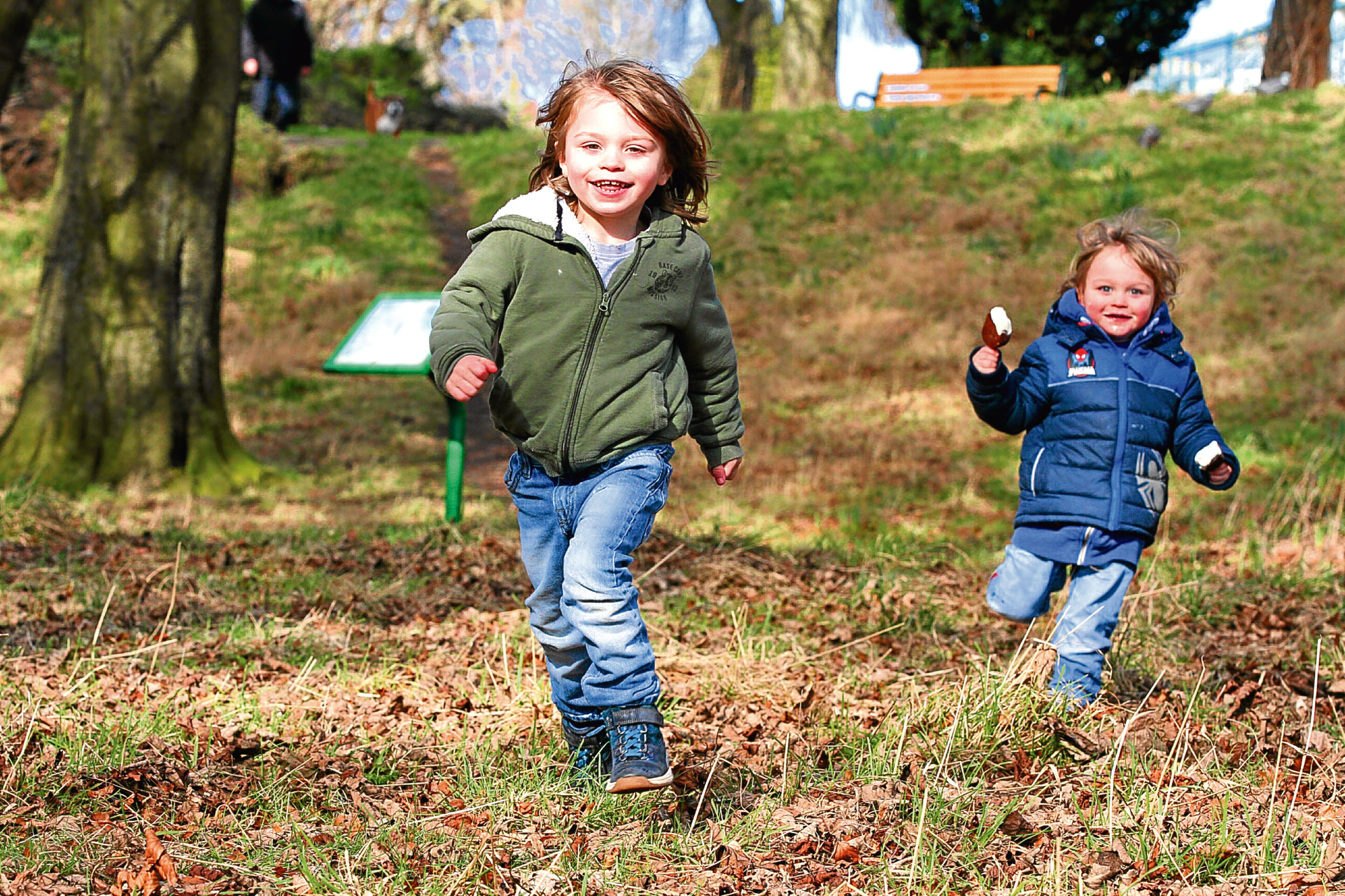 Three-year-old Callan Carr and his brother, Theo, two, take advantage of the good weather at Baxter Park.