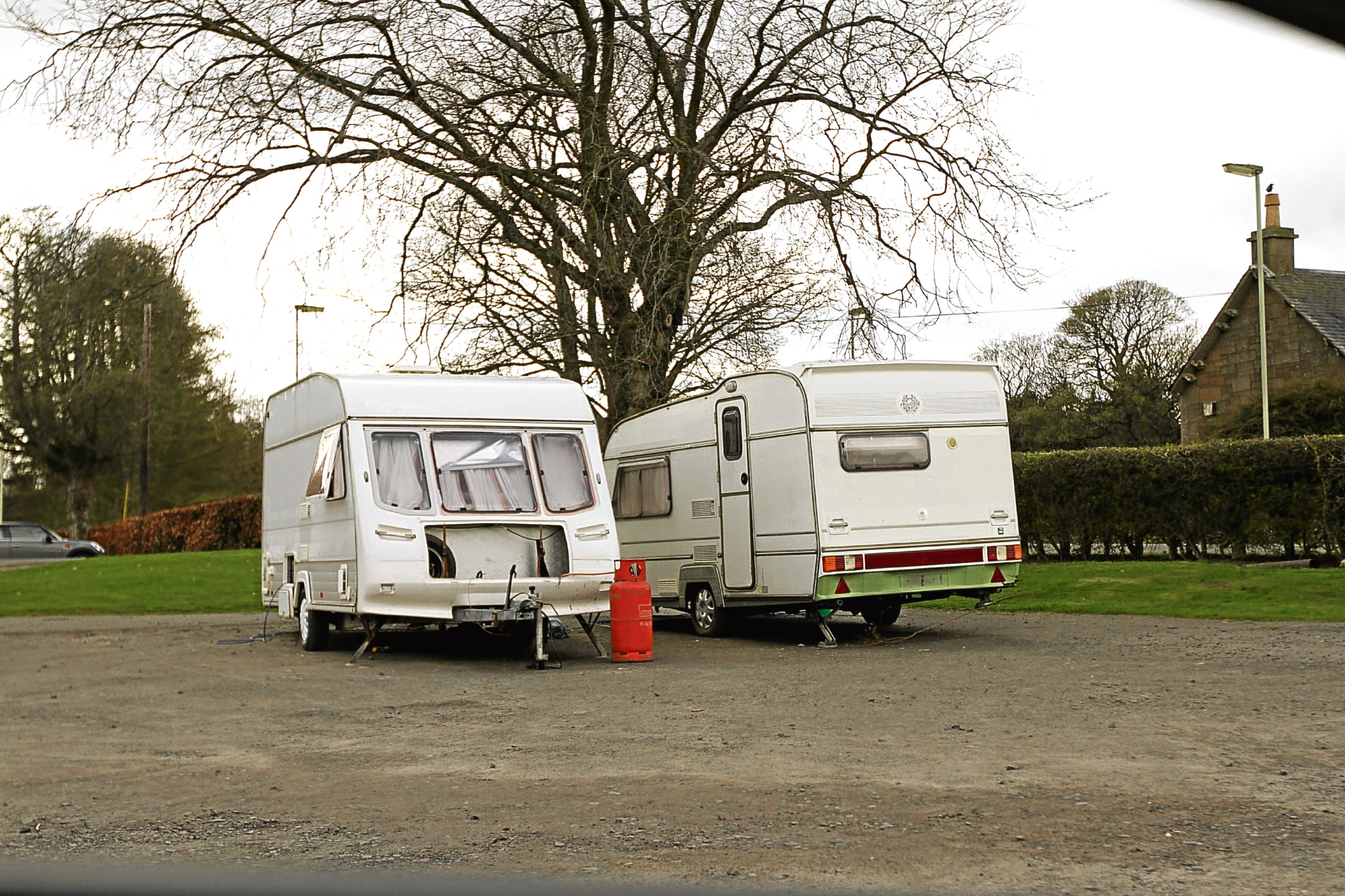 Dundee City Council has said it is investigating after two caravans appeared in the car park at Caird Park.