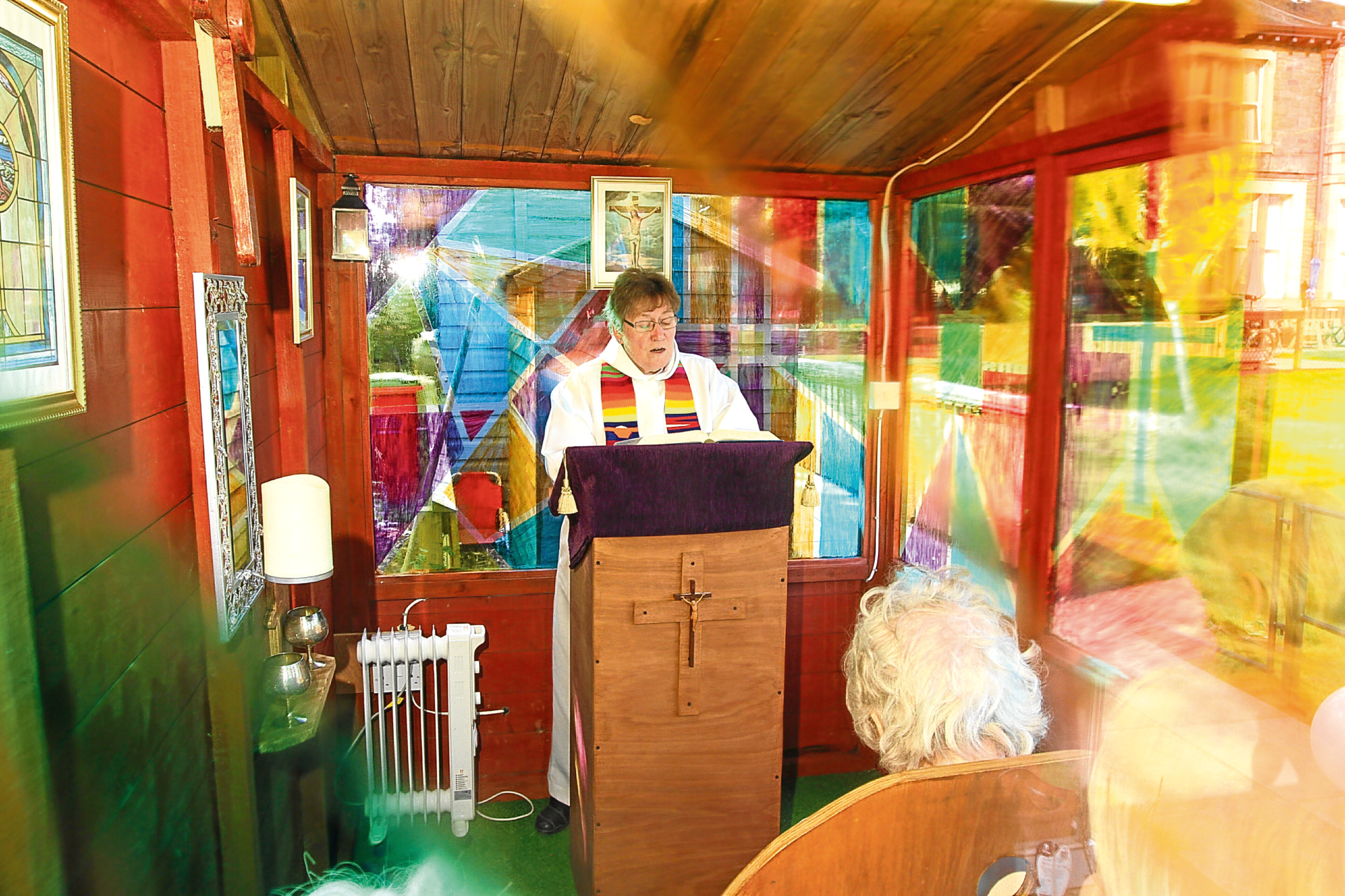 Rev Canon Fay Lamont holds the first service in the new chapel at Balcarres Care Home.