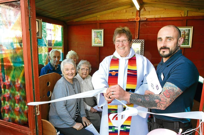 Rev Canon Fay Lamont with Craig Petrie and residents Yvonne Doig, Teresa Fenwick, Ken MacGregor and Jean Wilson.