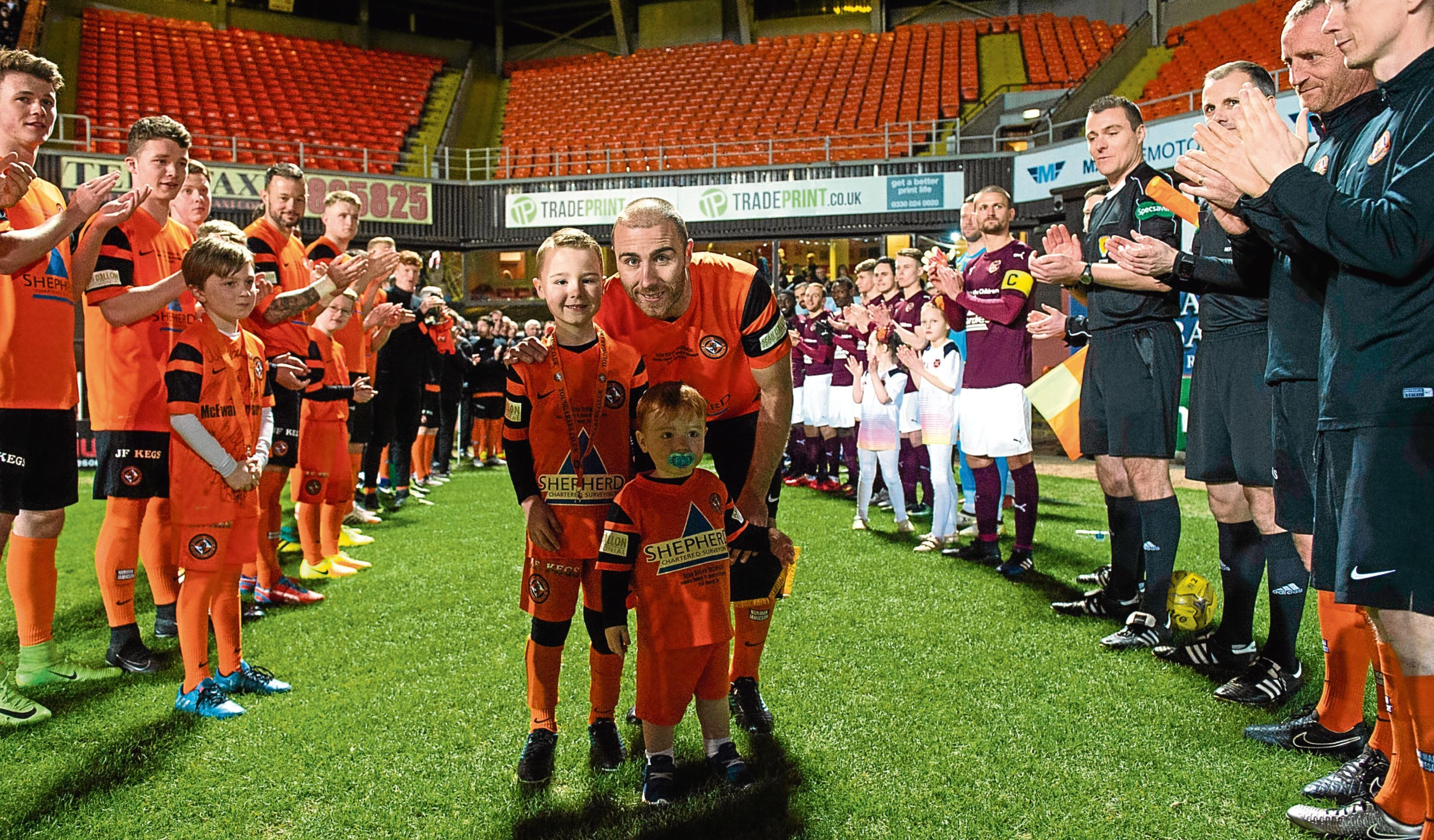 Sean Dillon poses with his sons in a guard of honour before his testimonial match with Hearts at Tannadice back in March.