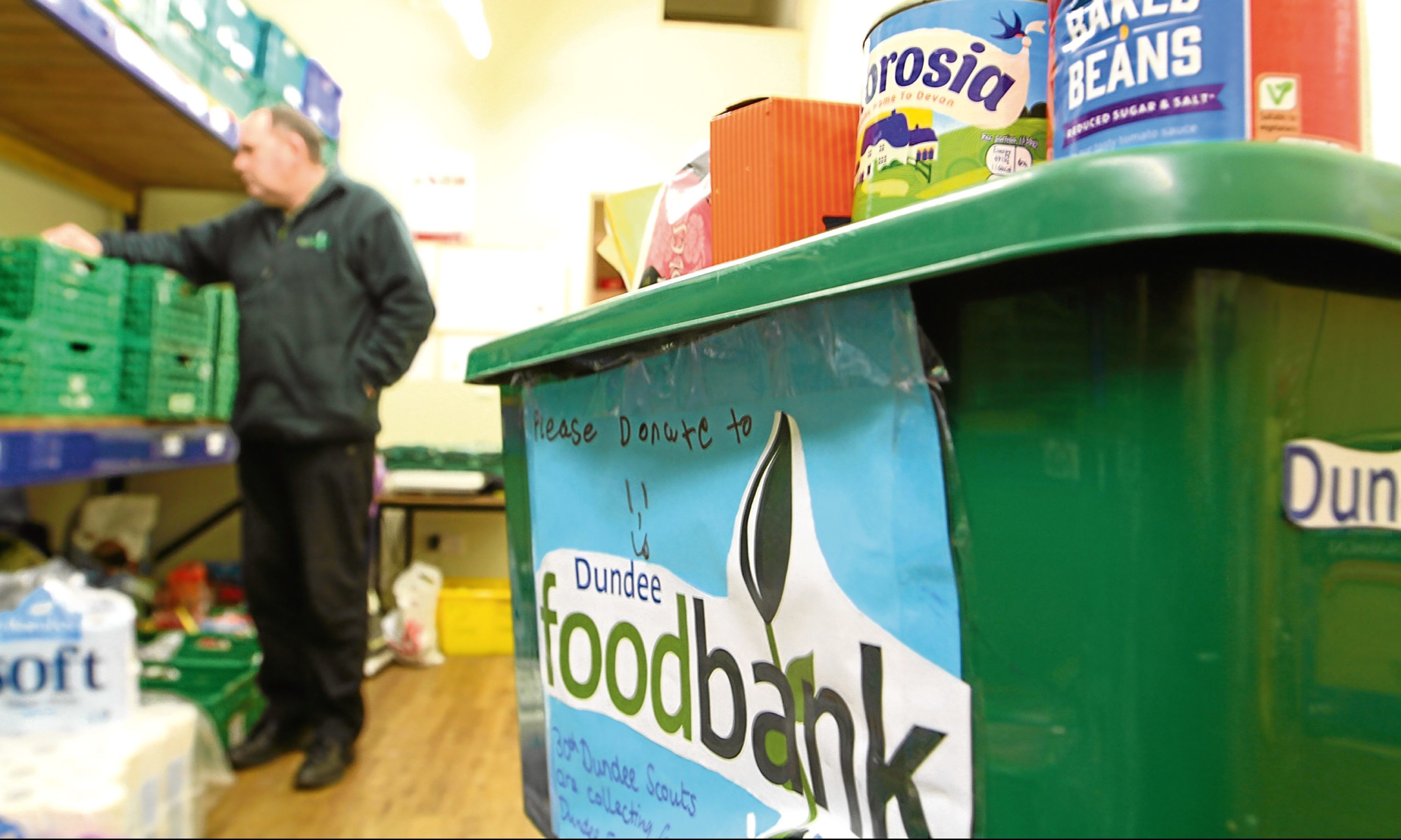 Ken Linton, Dundee Foodbank manager, gets ready to sort the next delivery