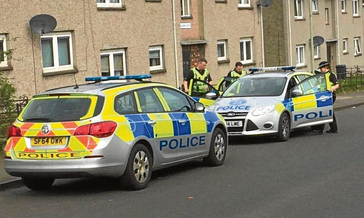 Police in Charleston after reports of a robbery at a house in Craigowan Road