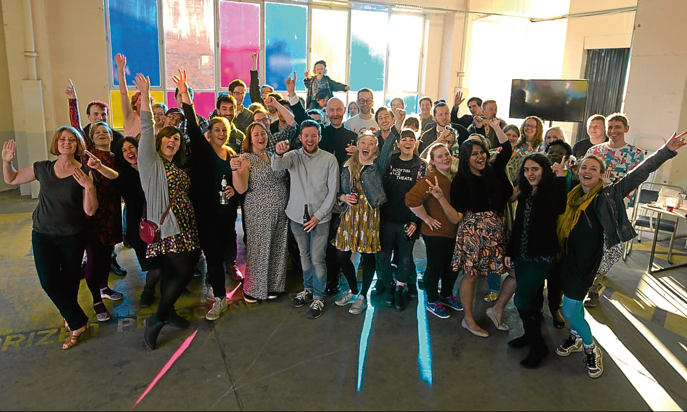 An appeal has been made for people from all walks of life to take part in the Dundee Design Festival. Pictured are volunteers at last year's event.