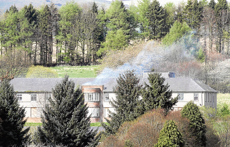 Strathmartine Hospital on fire.