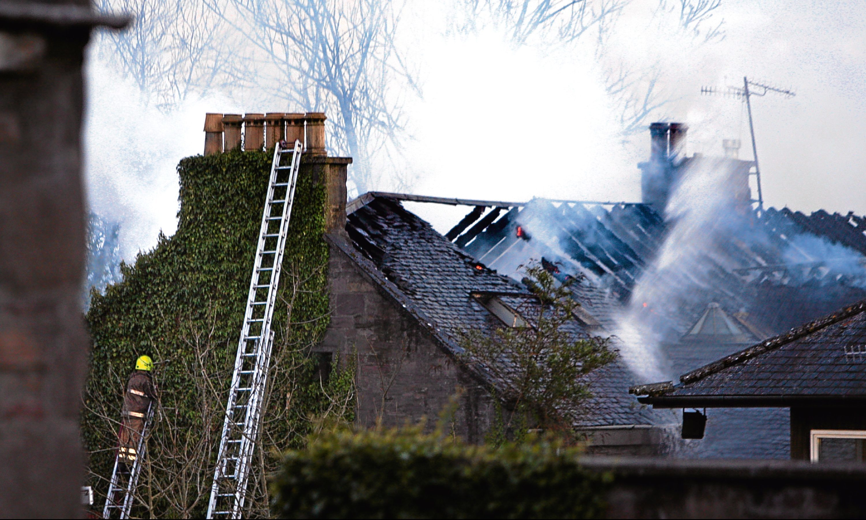 Firefighters tackle the blaze at the property in Forebank Road