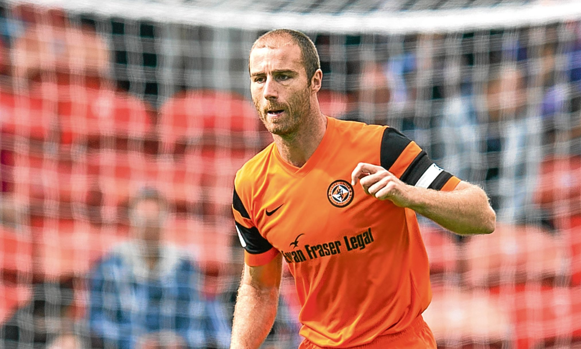 Dundee United skipper Sean Dillon in action
