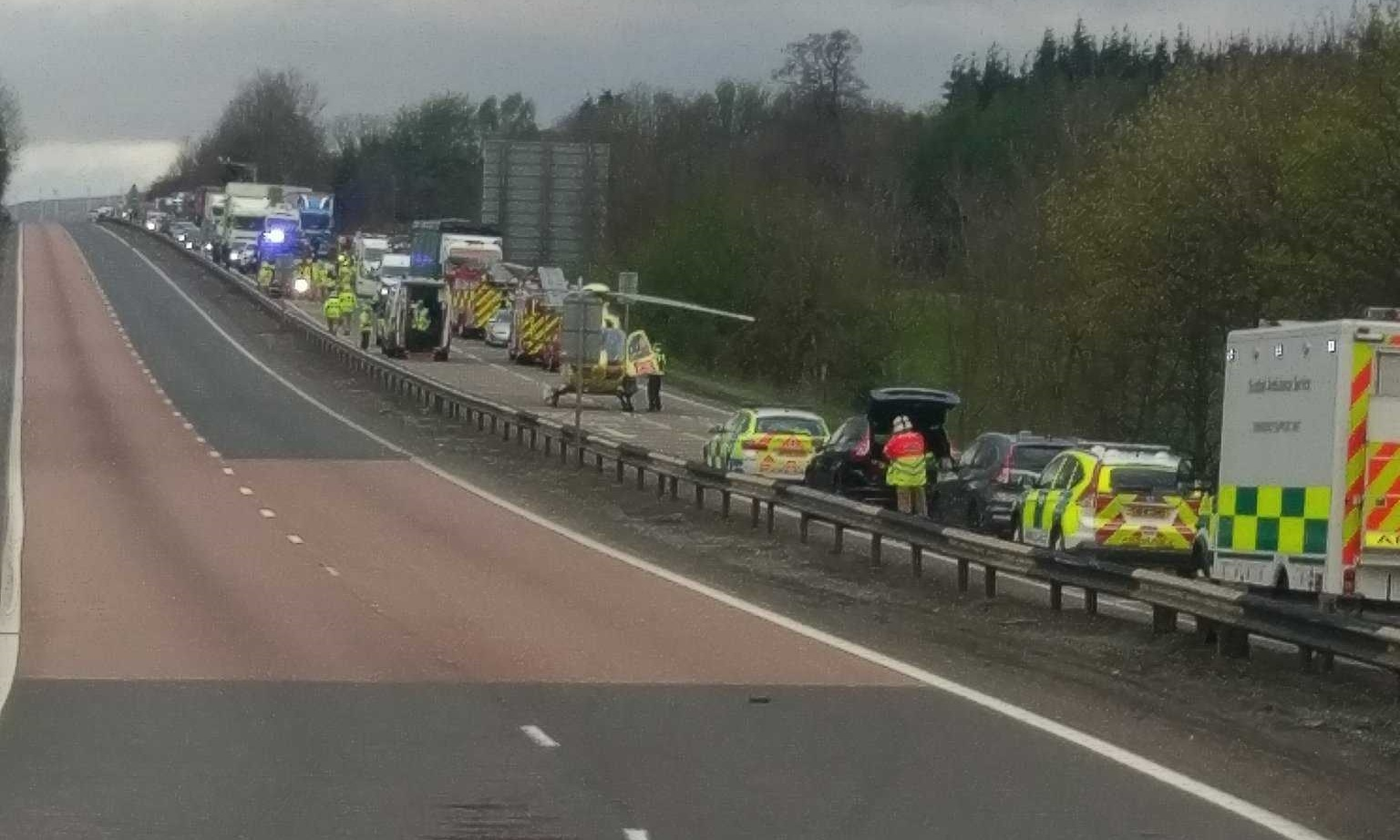 The air ambulance landed on the road to airlift at least one of the casualties to hospital.
