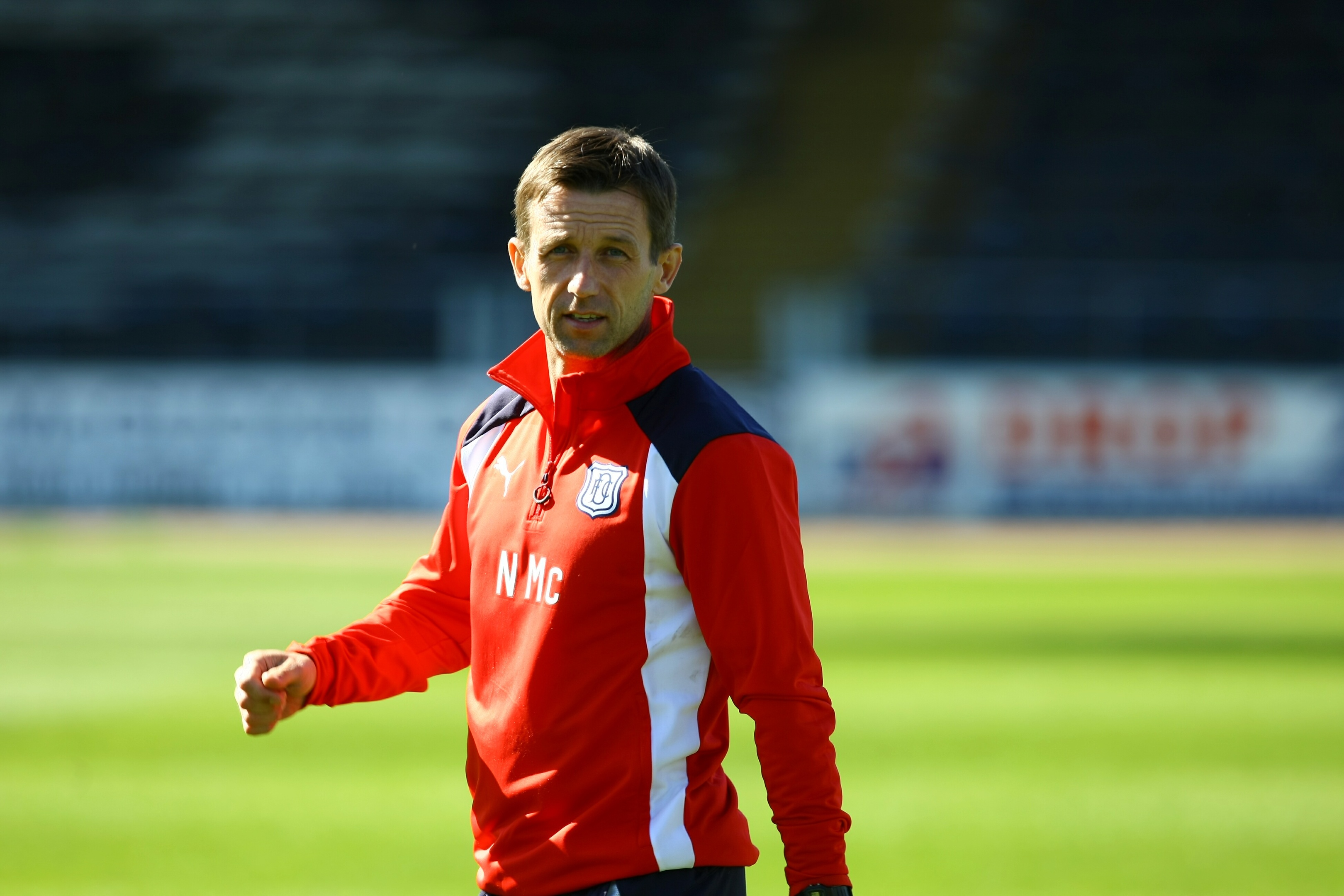 Neil McCann taking charge of a Dundee training session
