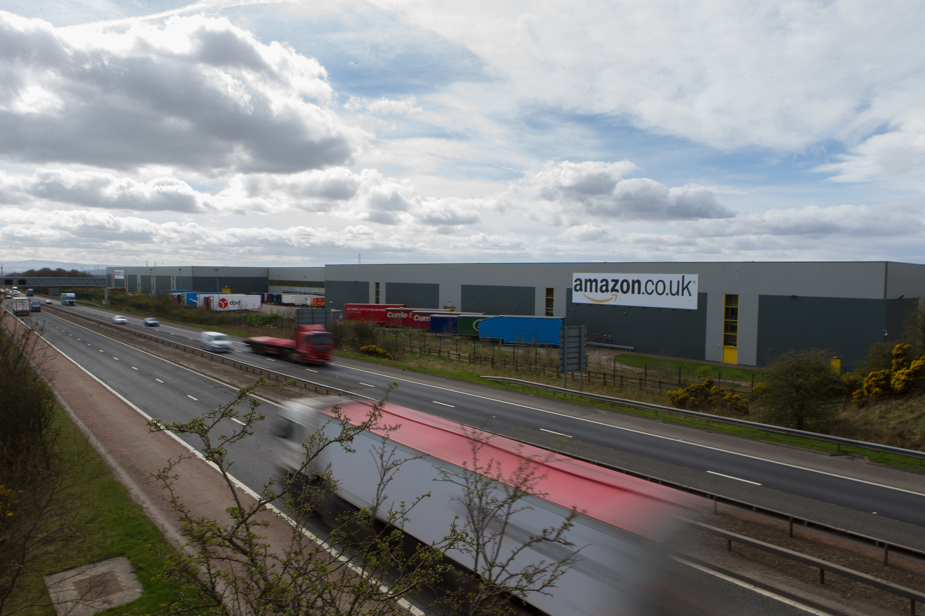 The Amazon distribution facility in Dunfermline alongside the M90