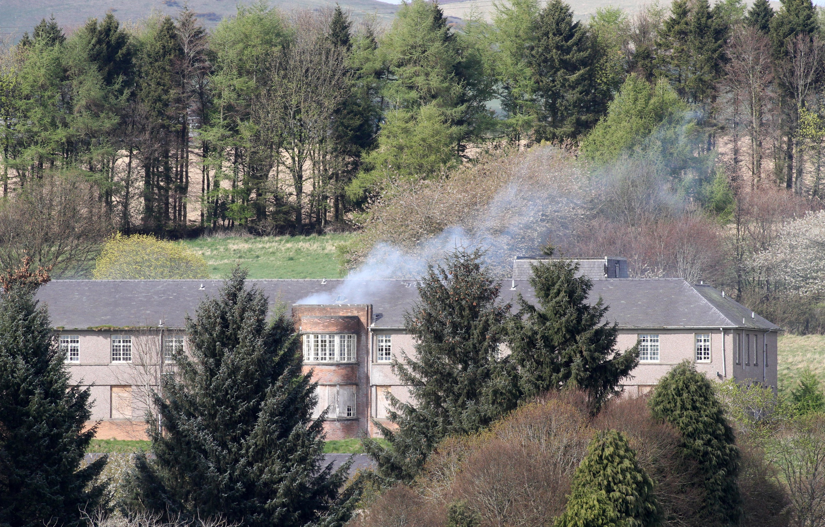 Smoke billows from the abandoned Strathmartine Hospital