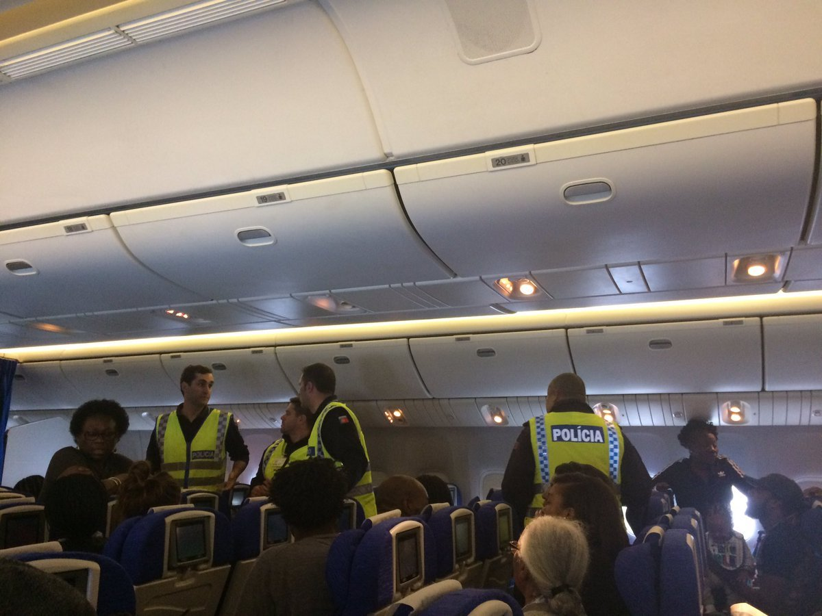 Police officers on the plane after the flight was diverted.