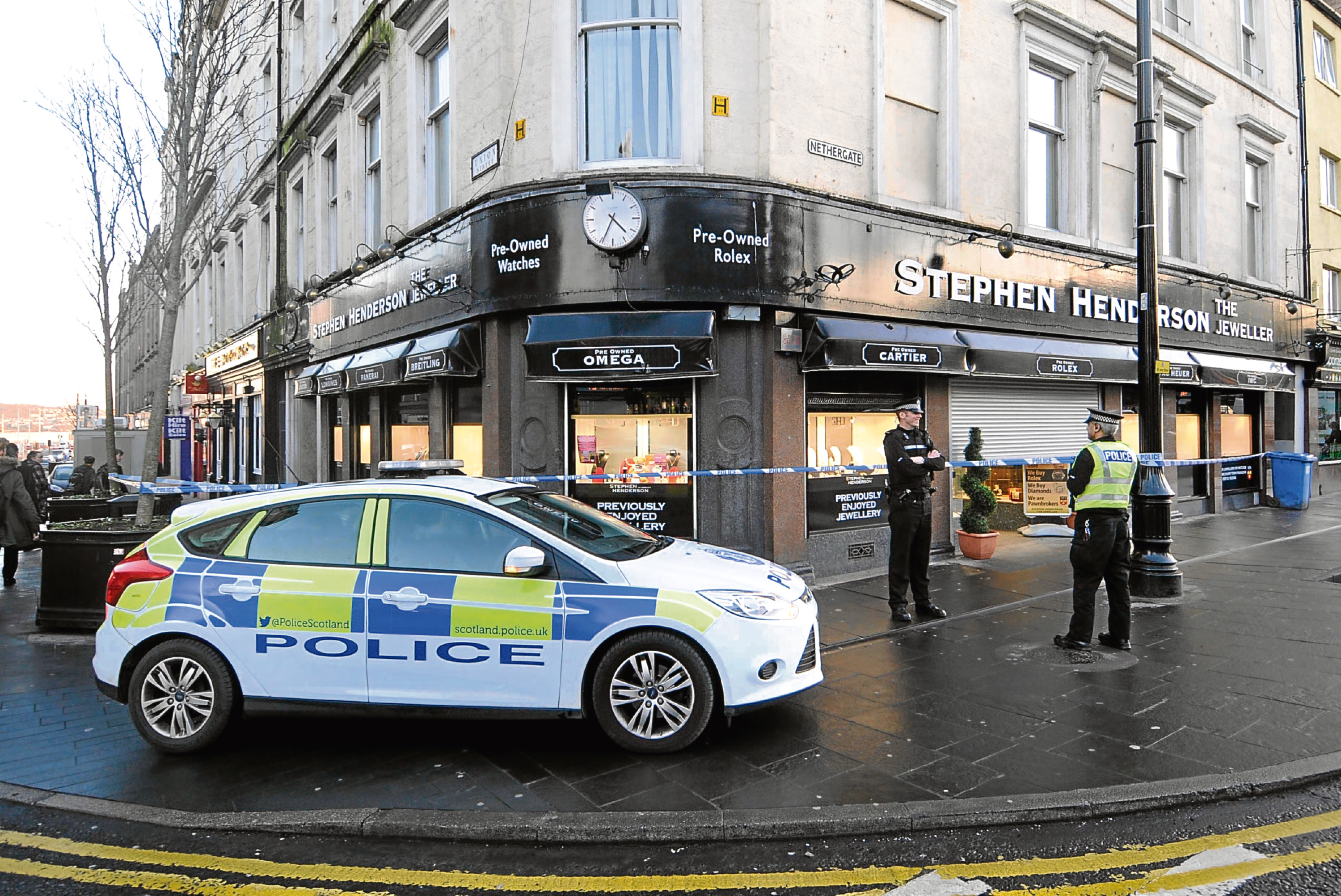 Police at Stephen Henderson Jewellers in the city centre in the aftermath of the alleged raid.