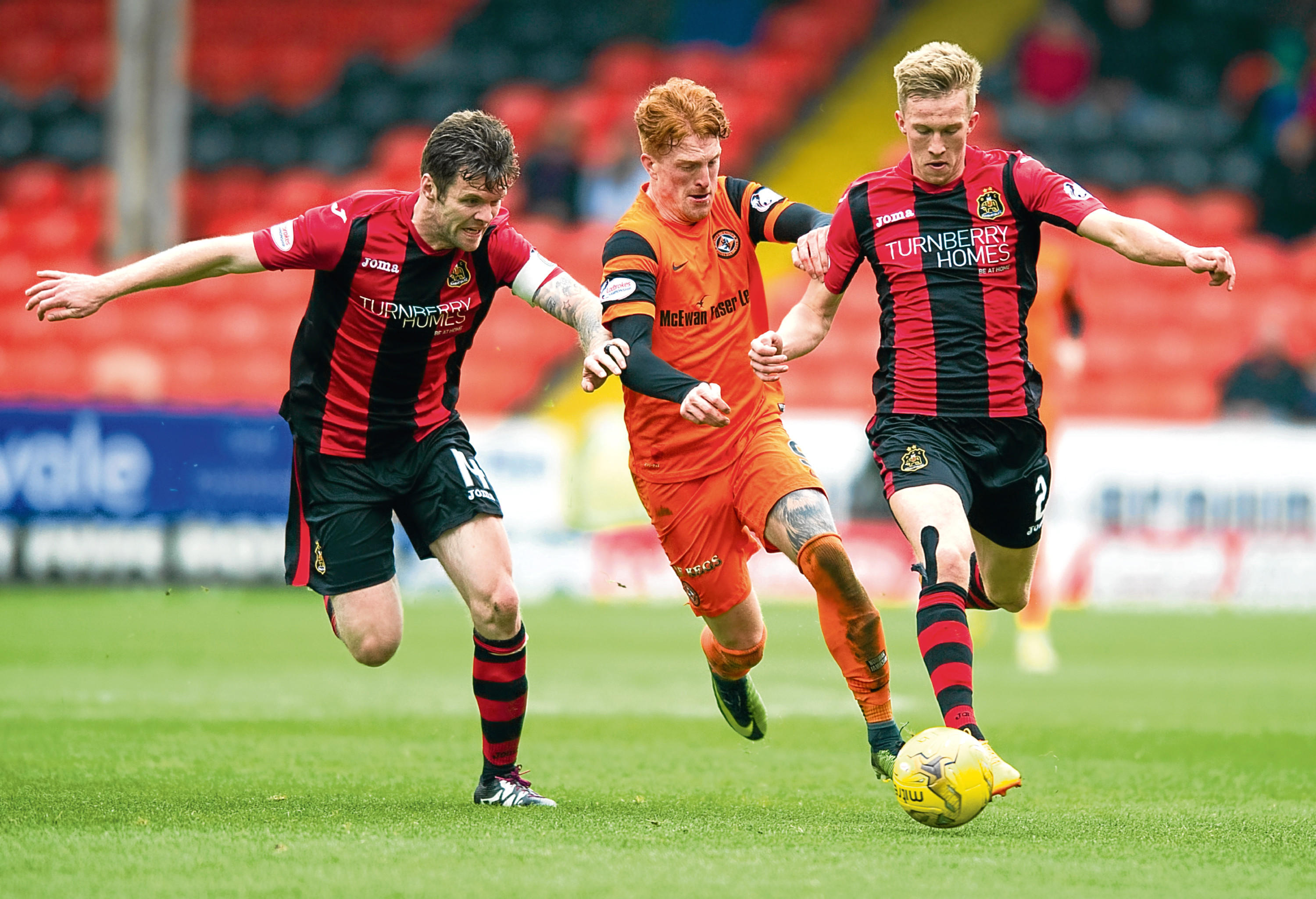 Simon Murray (centre) could have had a handful of goals.