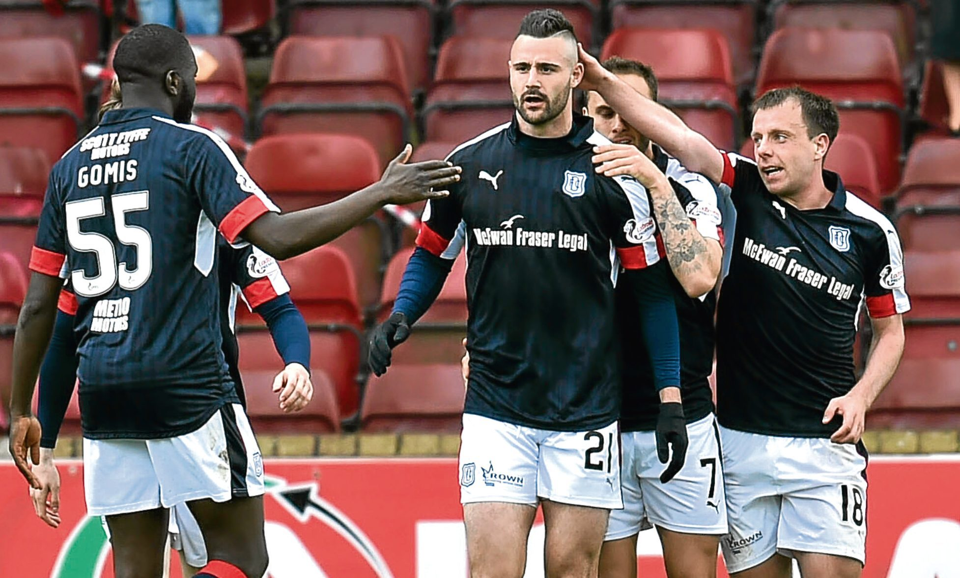 Dundee's Marcus Haber celebrates his goal in the 3-2 win over Motherwell