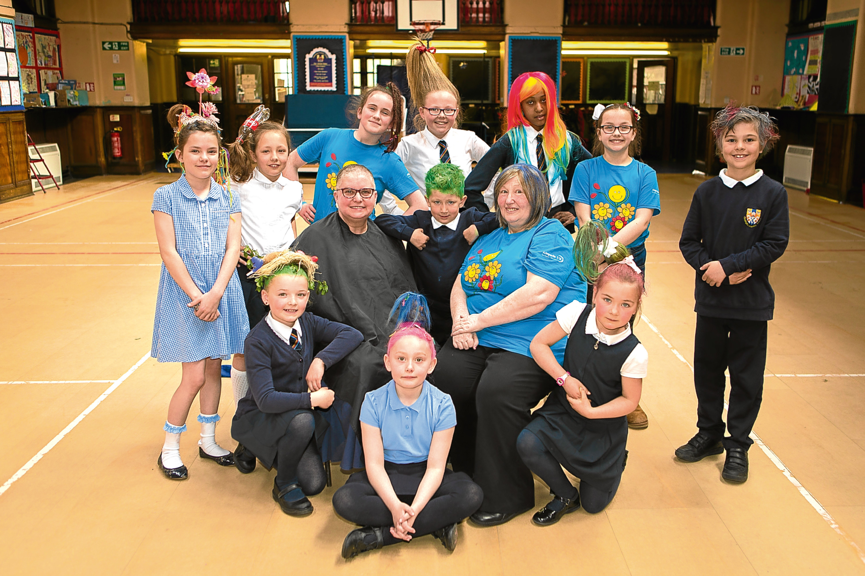 Picture shows pupils sporting crazy hairstyles alongside Irene, Alopecia Awareness UK volunteer and sufferer Lorna Weir, and Murron (back, third left).