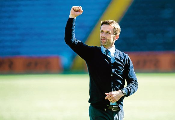 Dundee interim manager Neil McCann celebrates at full time