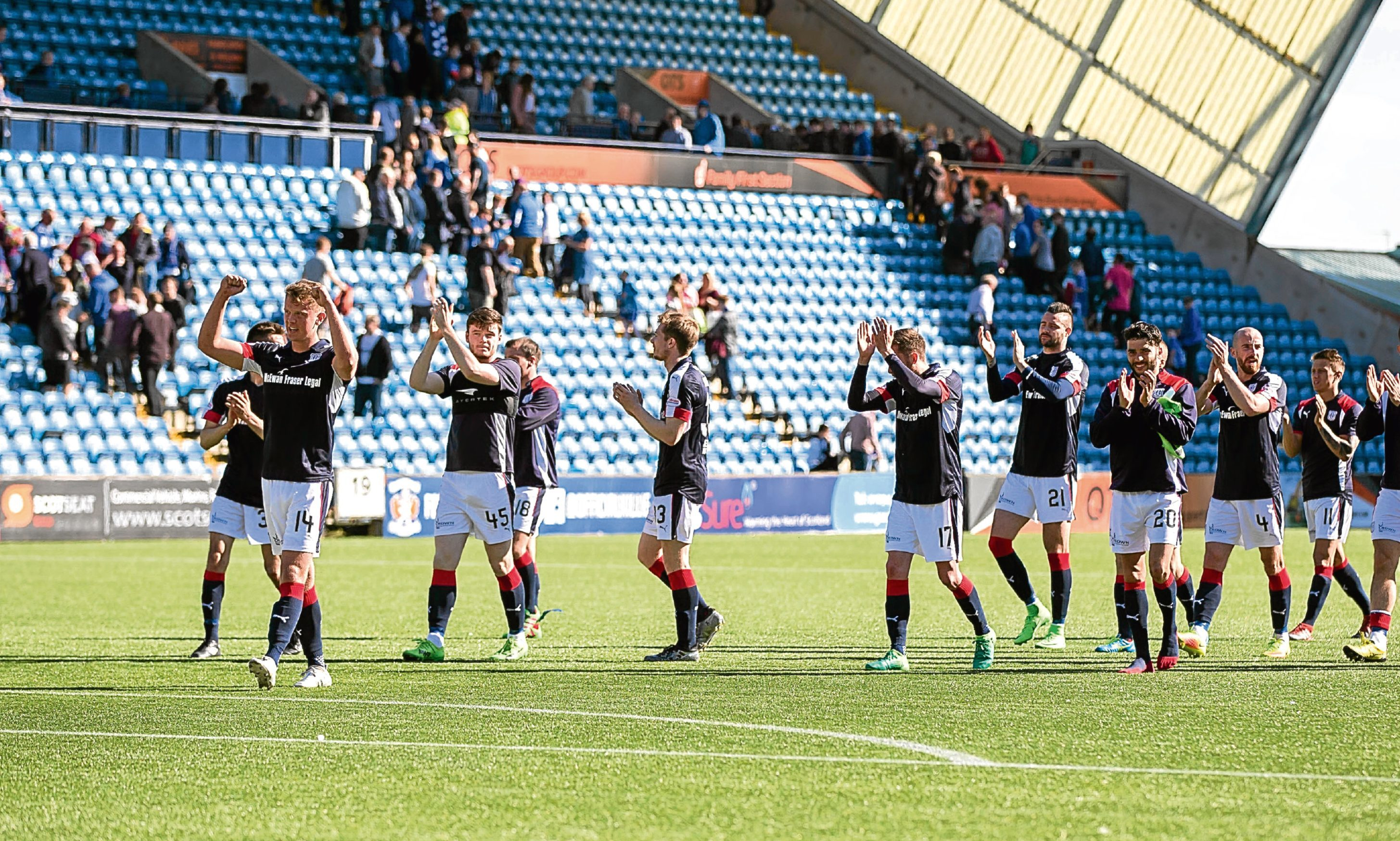 Dundee players applaud the visiting support after the 1-0 win at Kilmarnock on Saturday