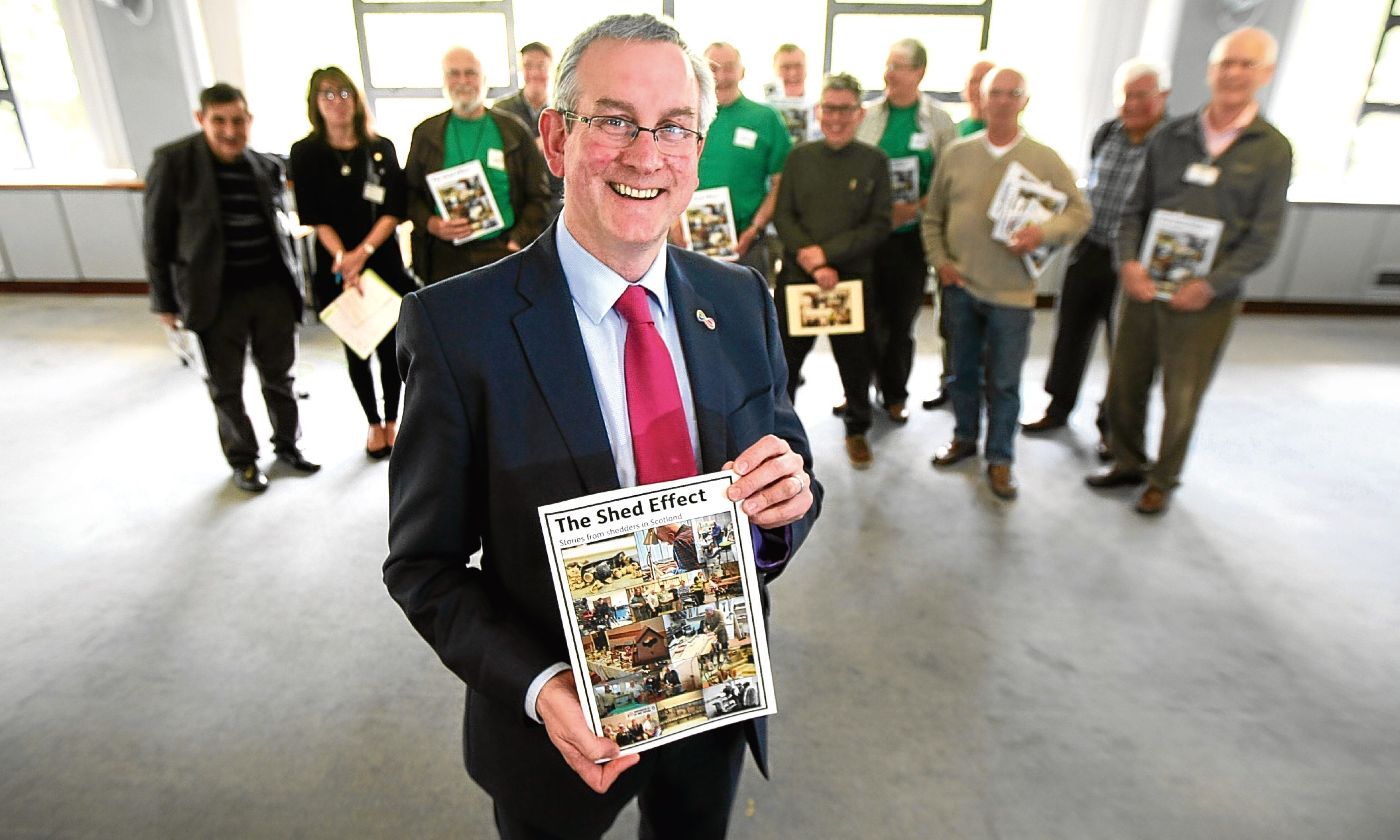 Keith Robson of Age Scotland with Men's Shed group members