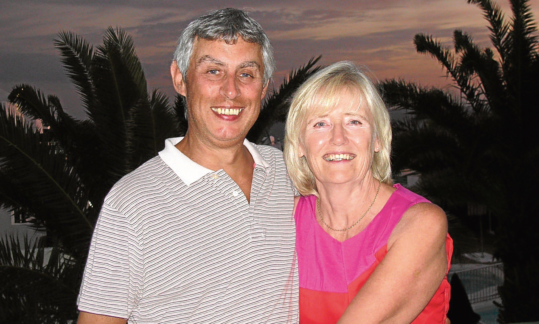Ex Dundee United director Derek Robertson with Sheila