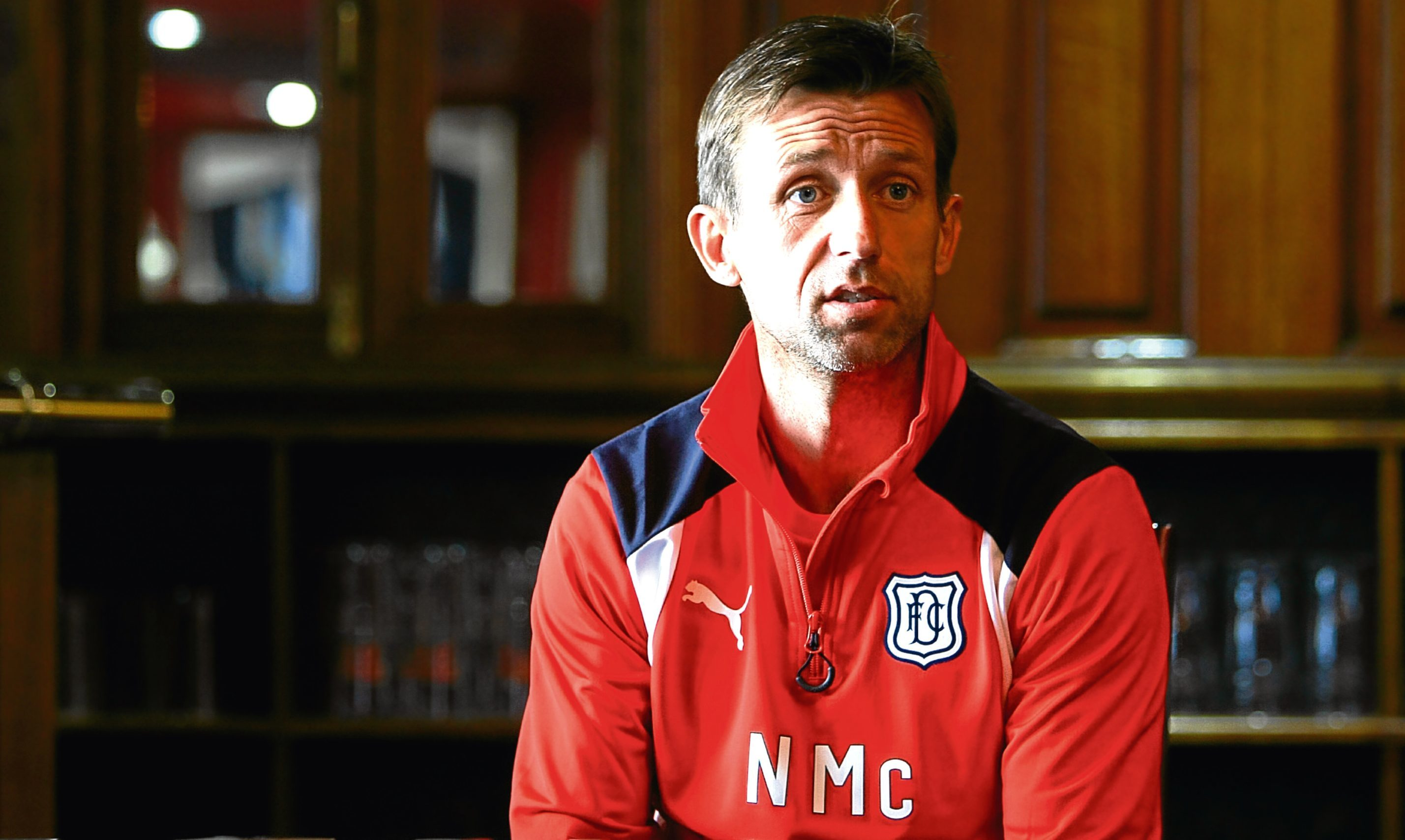 Dundee manager Neil McCann talking to the press at Dens Park