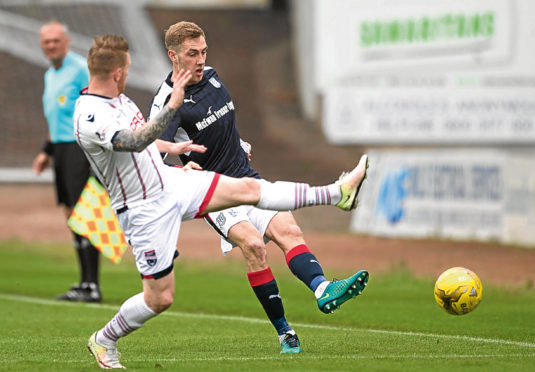 Dundee's Kevin Holt is put under pressure from Michael Gardyne the last time Ross County visited Dens Park.