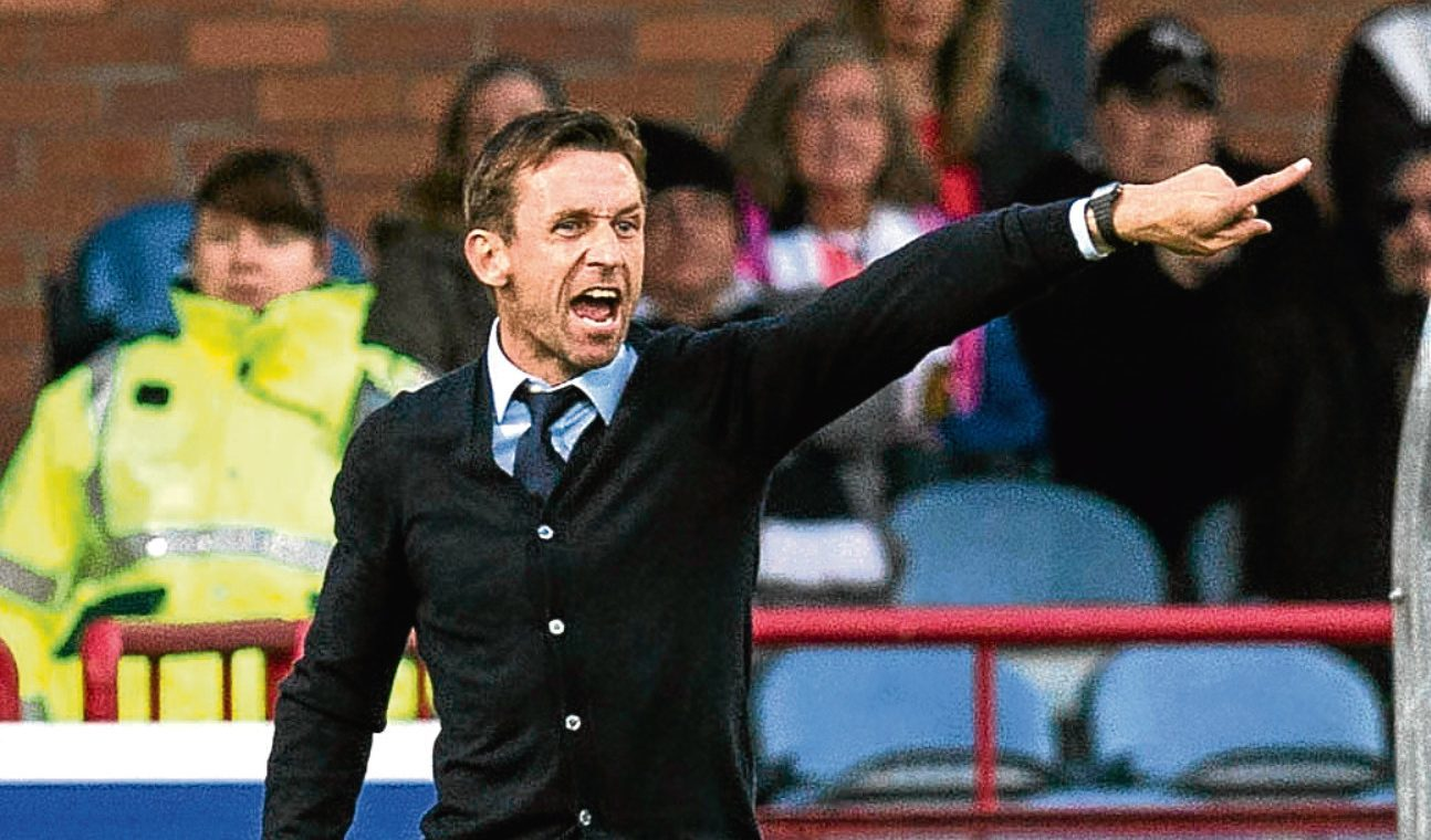 Neil McCann points the way from the touchline.