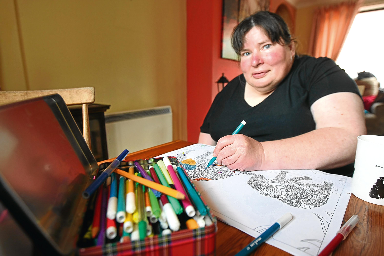 Jackie Kelly drawing at home