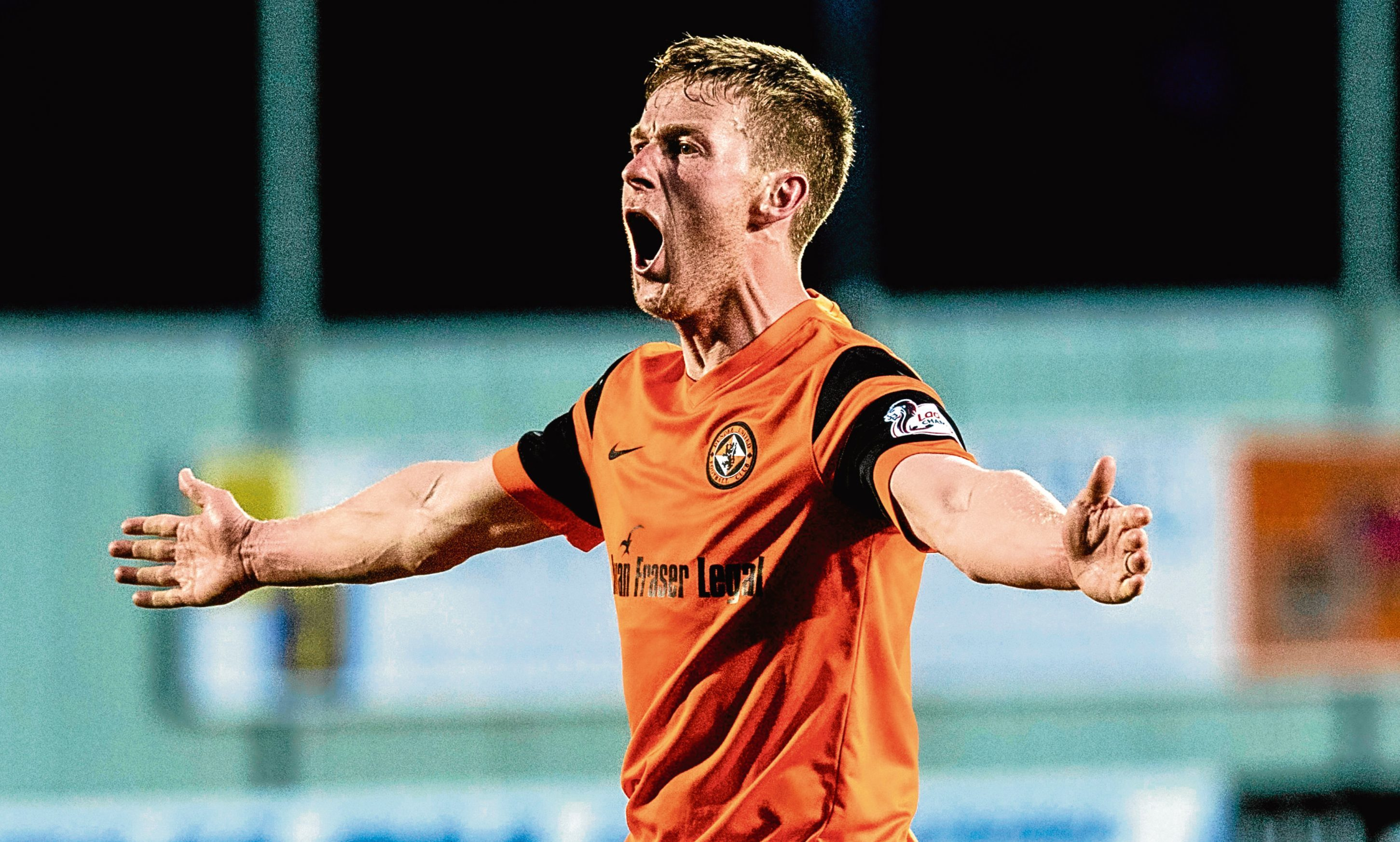 Paul Dixon celebrates grabbing the late winner for Dundee United in the play-off semi-final.