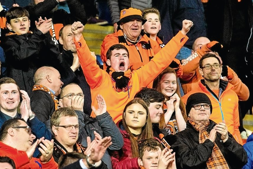 Tangerines fans applaud their team at full-time.