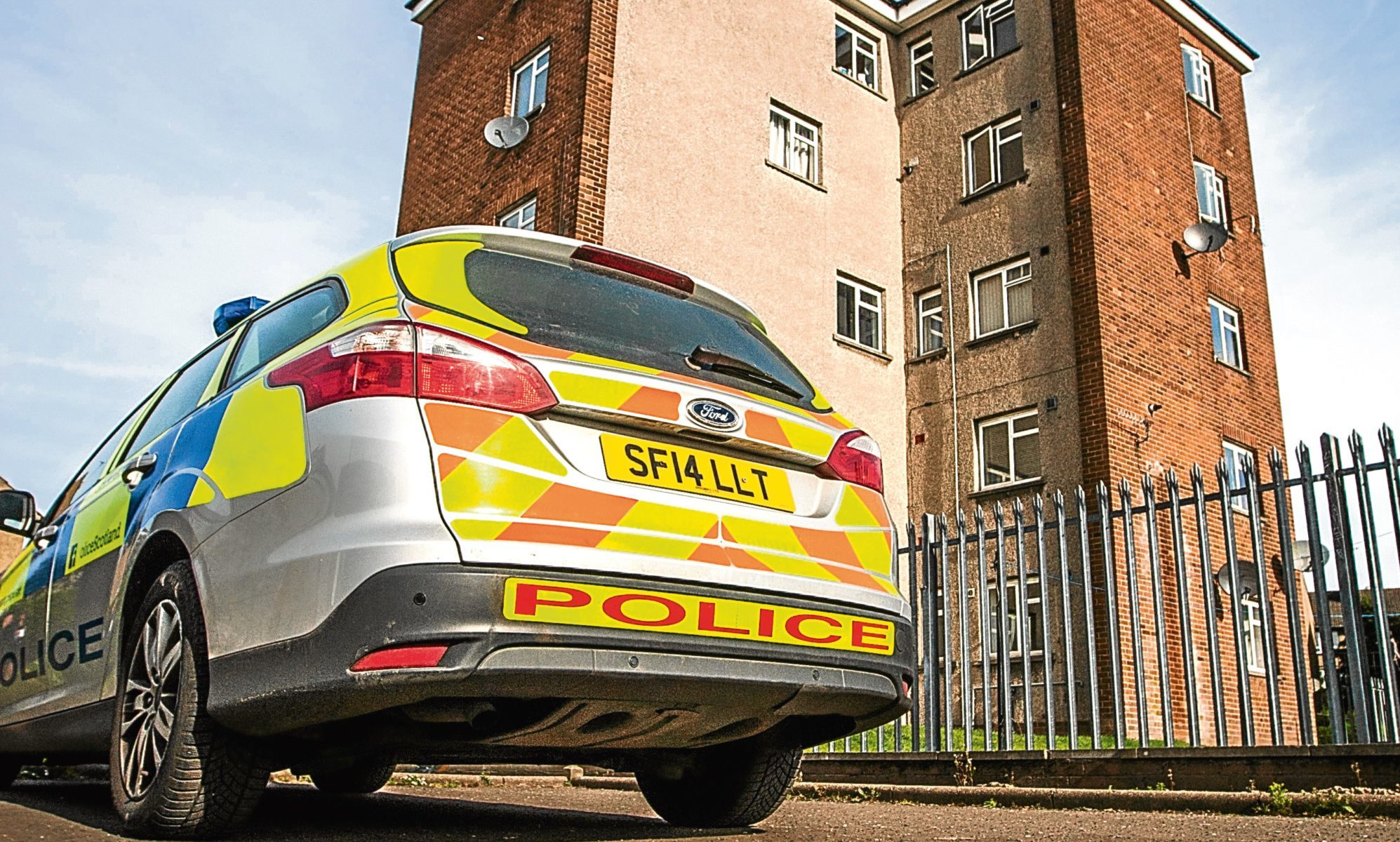 A police vehicle stationed outside a block on Kemnay Gardens.