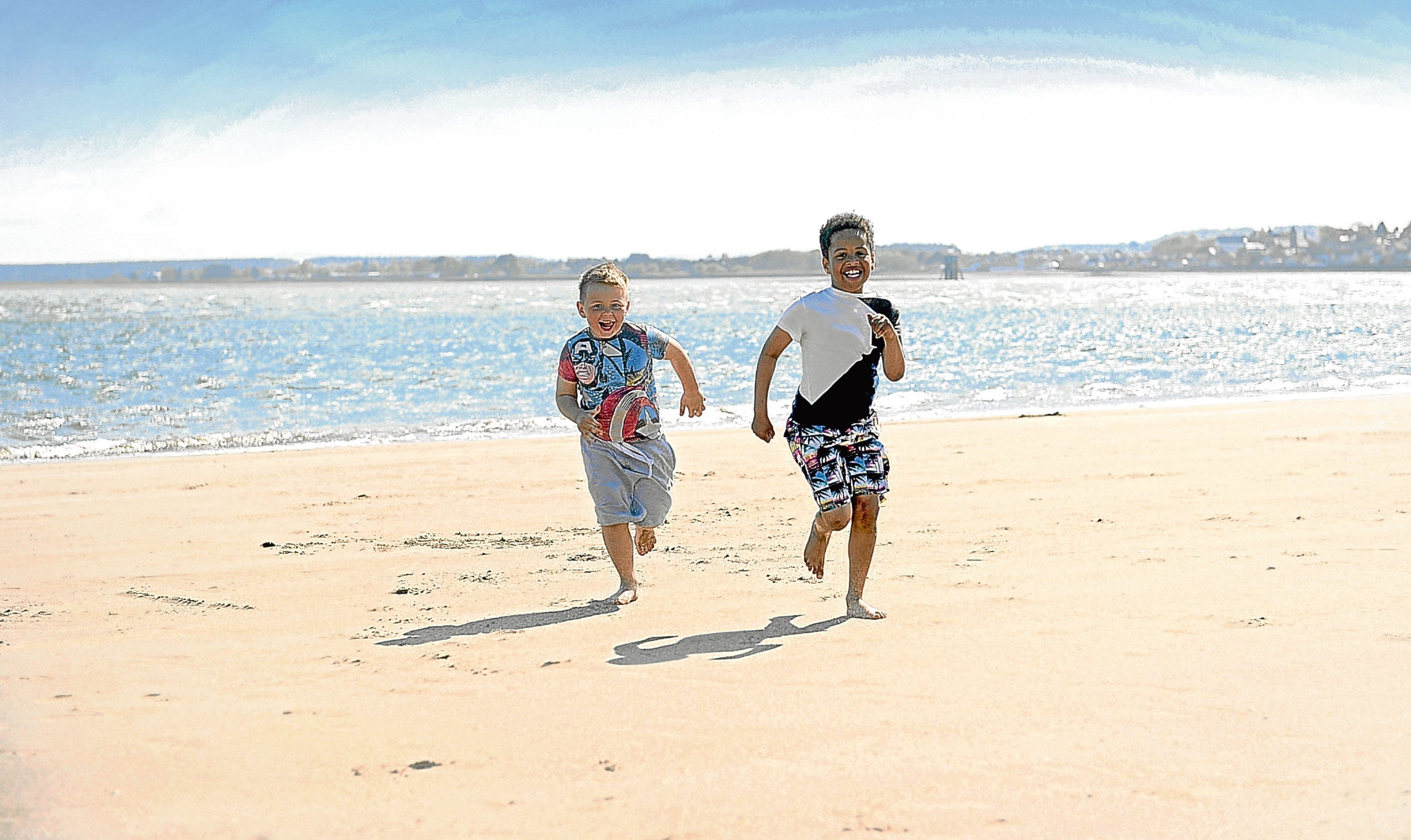 Reilly Fraser and Morris Muzividzi from Monifieth enjoy the sun on Broughty Beach earlier this month