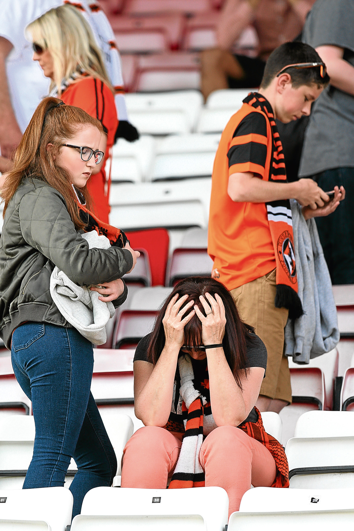 Courier/Tele News. Sport/News story. Hamilton V Dundee United in the Play off final. Dejected fan and player pics. Picture shows; dejected fans at full time whistle, Hamilton V Dundee United. Sunday, 28th May, 2017.