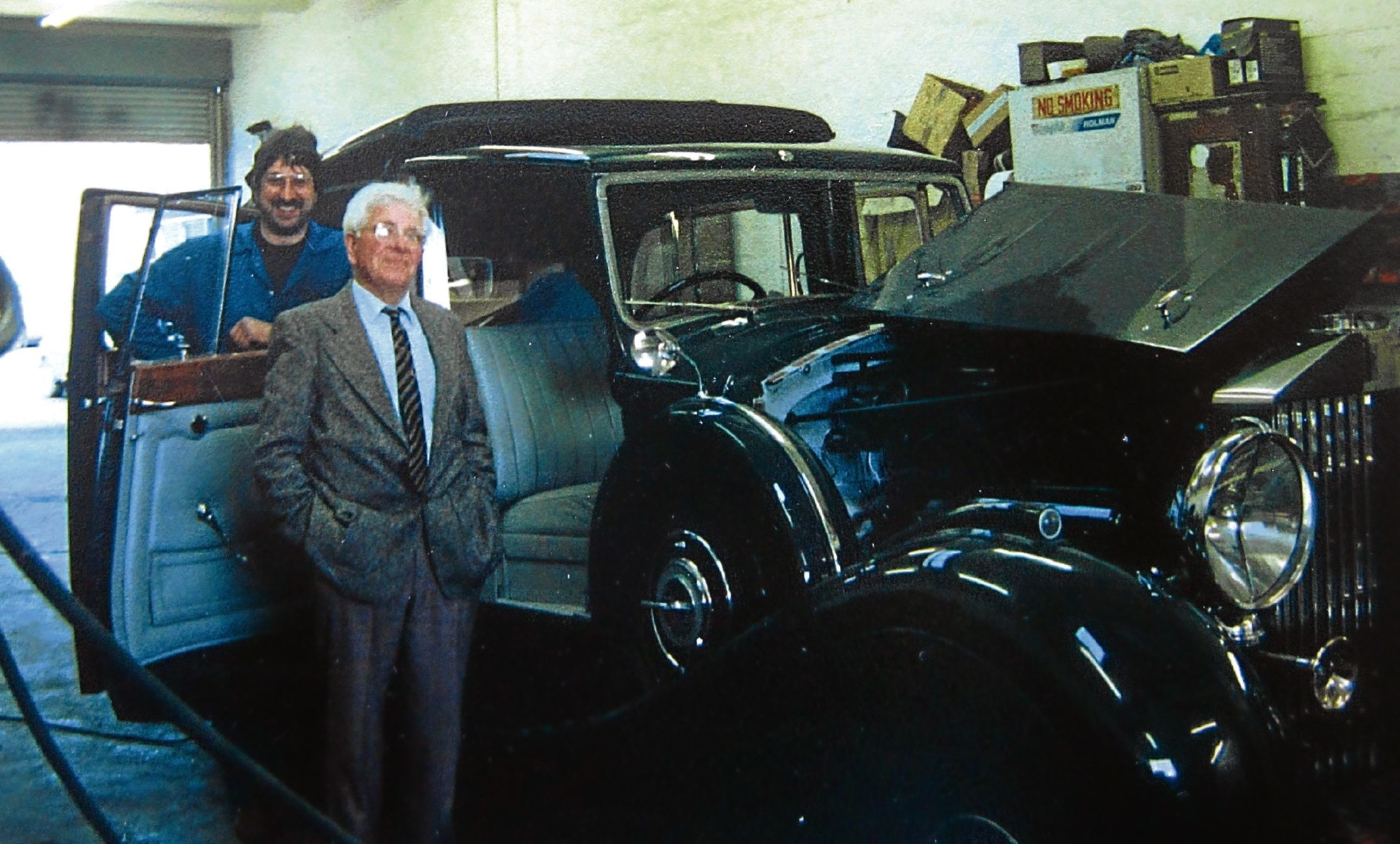 Charles McGilchrist with Brian Clark of Clark Hardie garage in Lochee, working on restoring a Packard classic car owned by Sir James Cayzer.