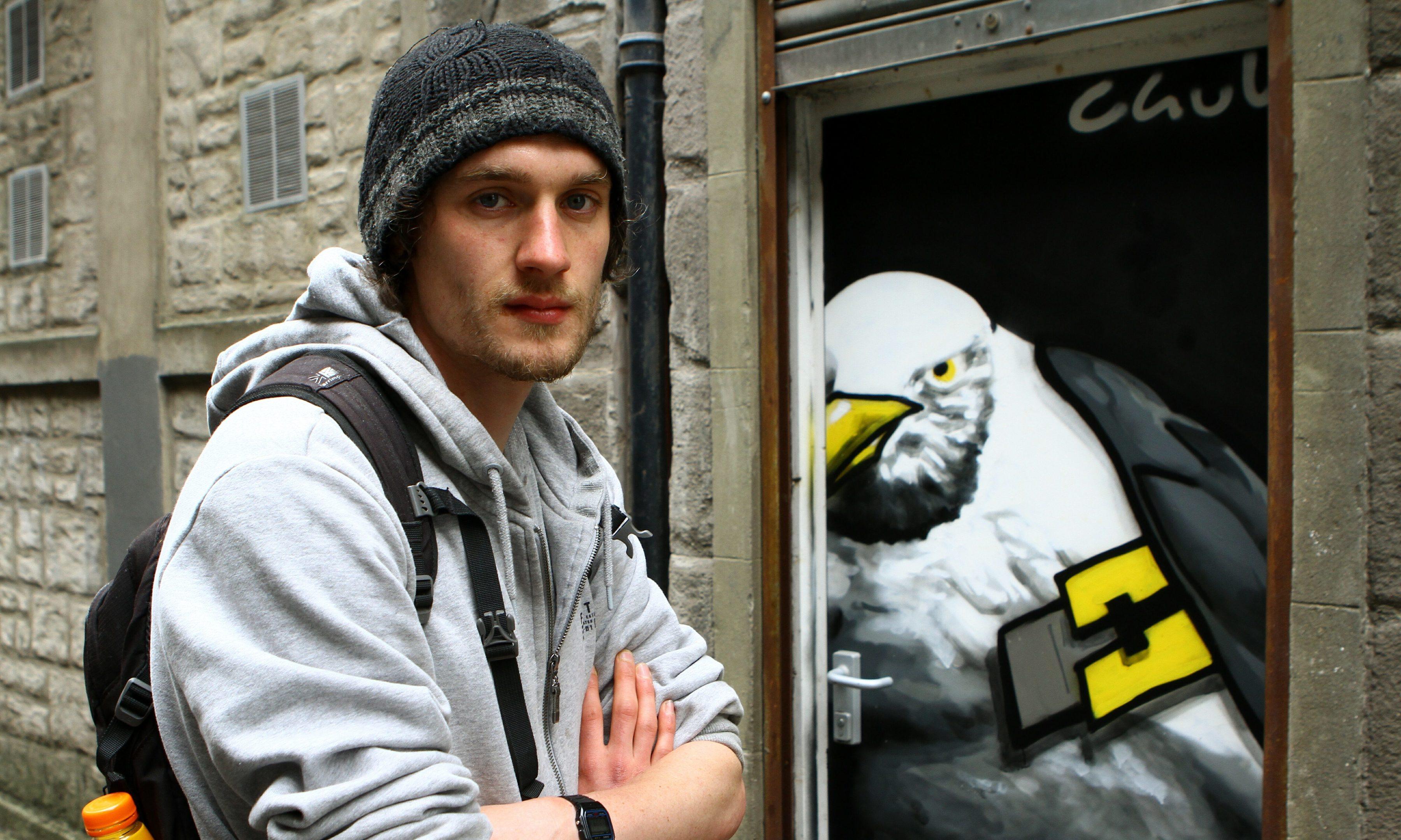 Craig Crawford beside his door in Couttie's Wynd, one of the doors in the 'Unloved Doors' project