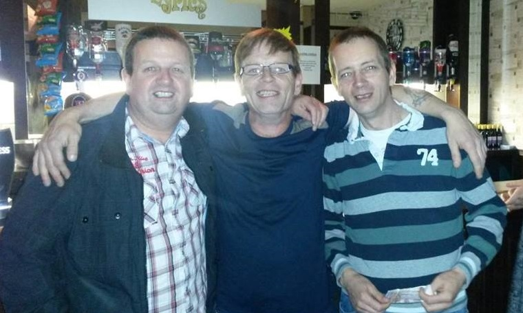 Gary Anderson (right) with brothers David (left) and James (centre). The 47-year-old was found dead in his home.