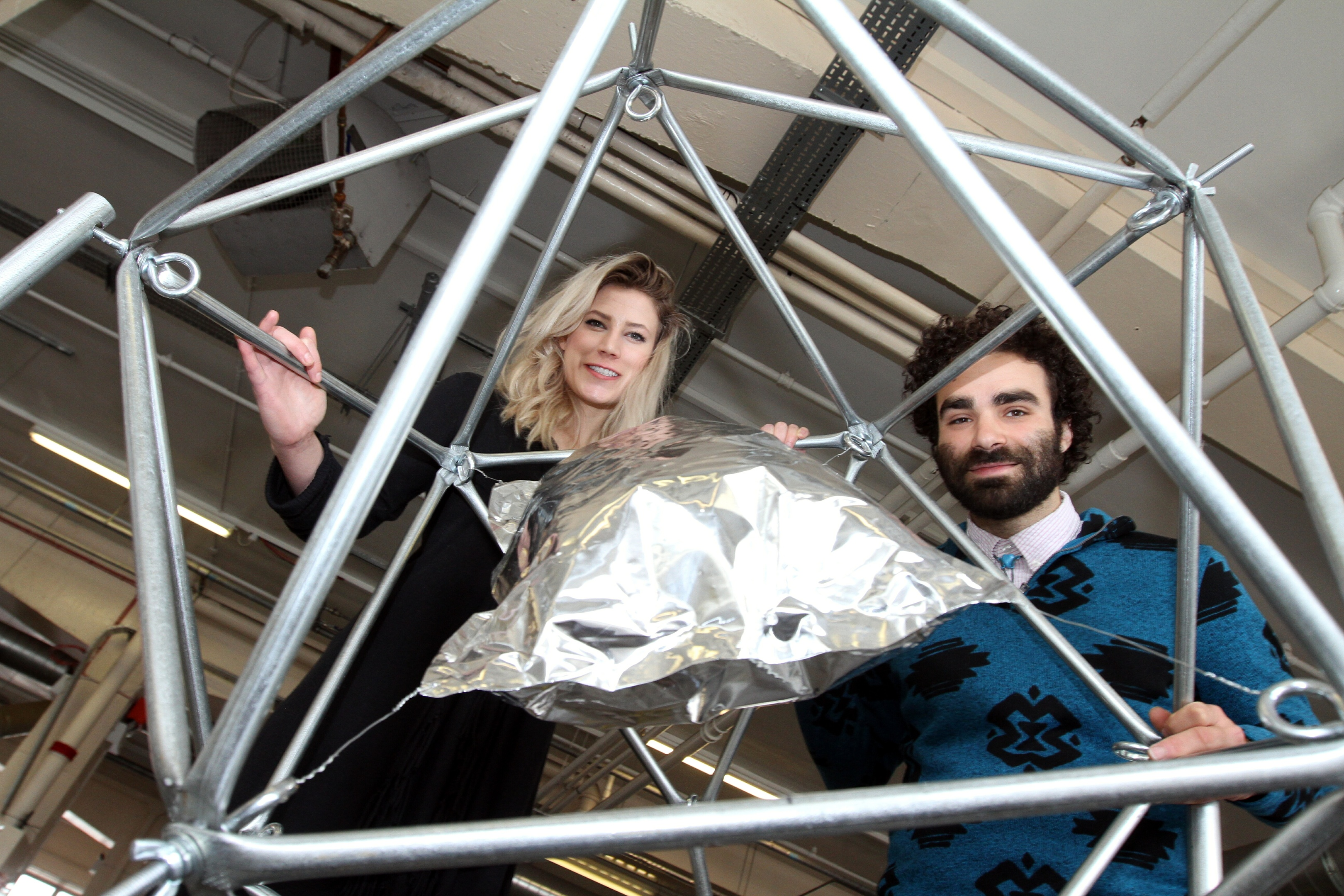 """Rachel Mulder and Simon Anton who are part of """"Thing Thing"""" from Detroit with their creation """"Ike Junior."""""""