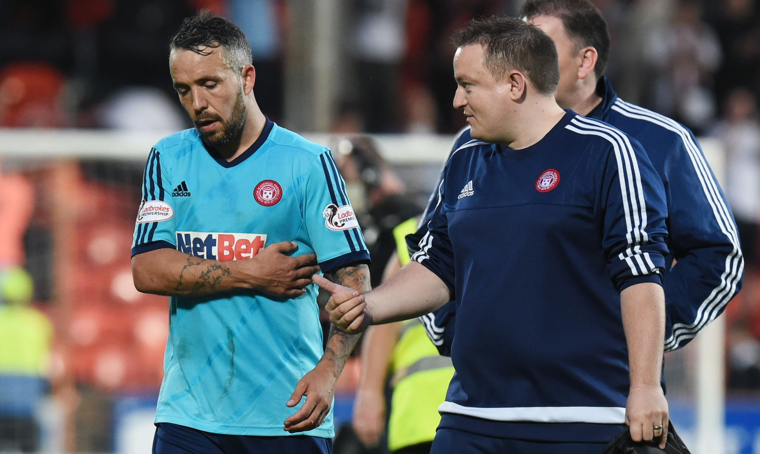 Hamilton's Dougie Imrie leaves the field after suffering an injury against Dundee United