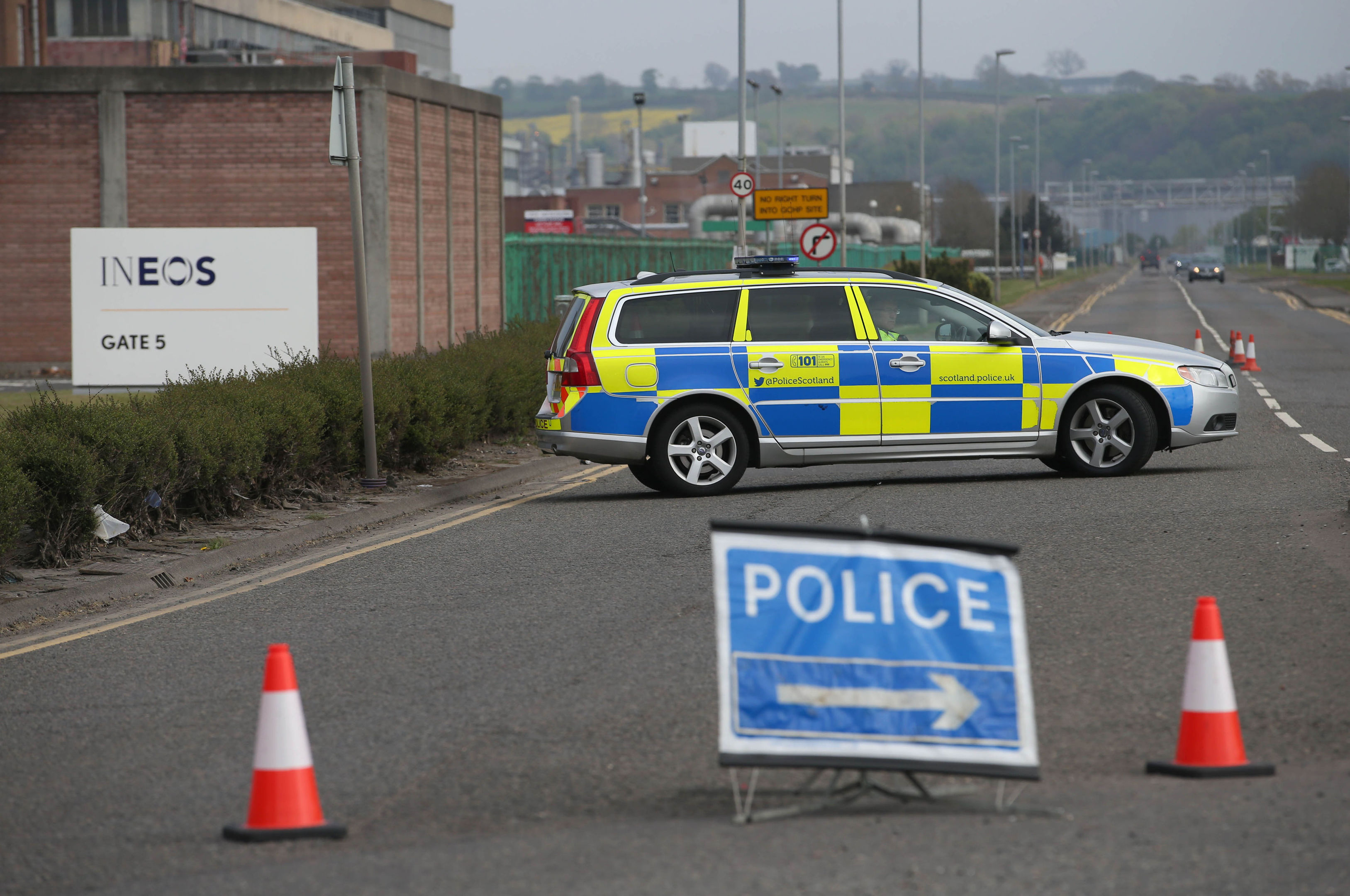 A police car blocks the entrance to the petrochemical plant in Grangemouth.