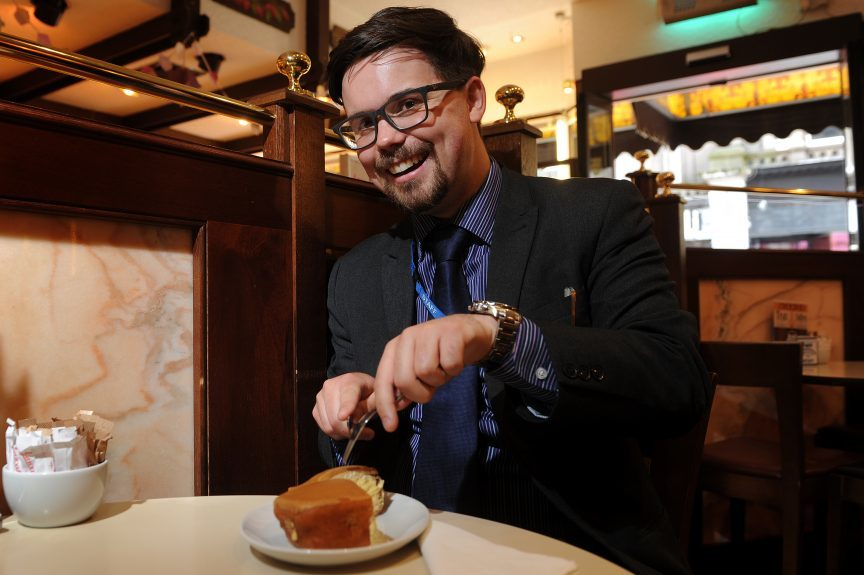 Jon's tucks into a Fisher and Donaldson doughnut — with cutlery!
