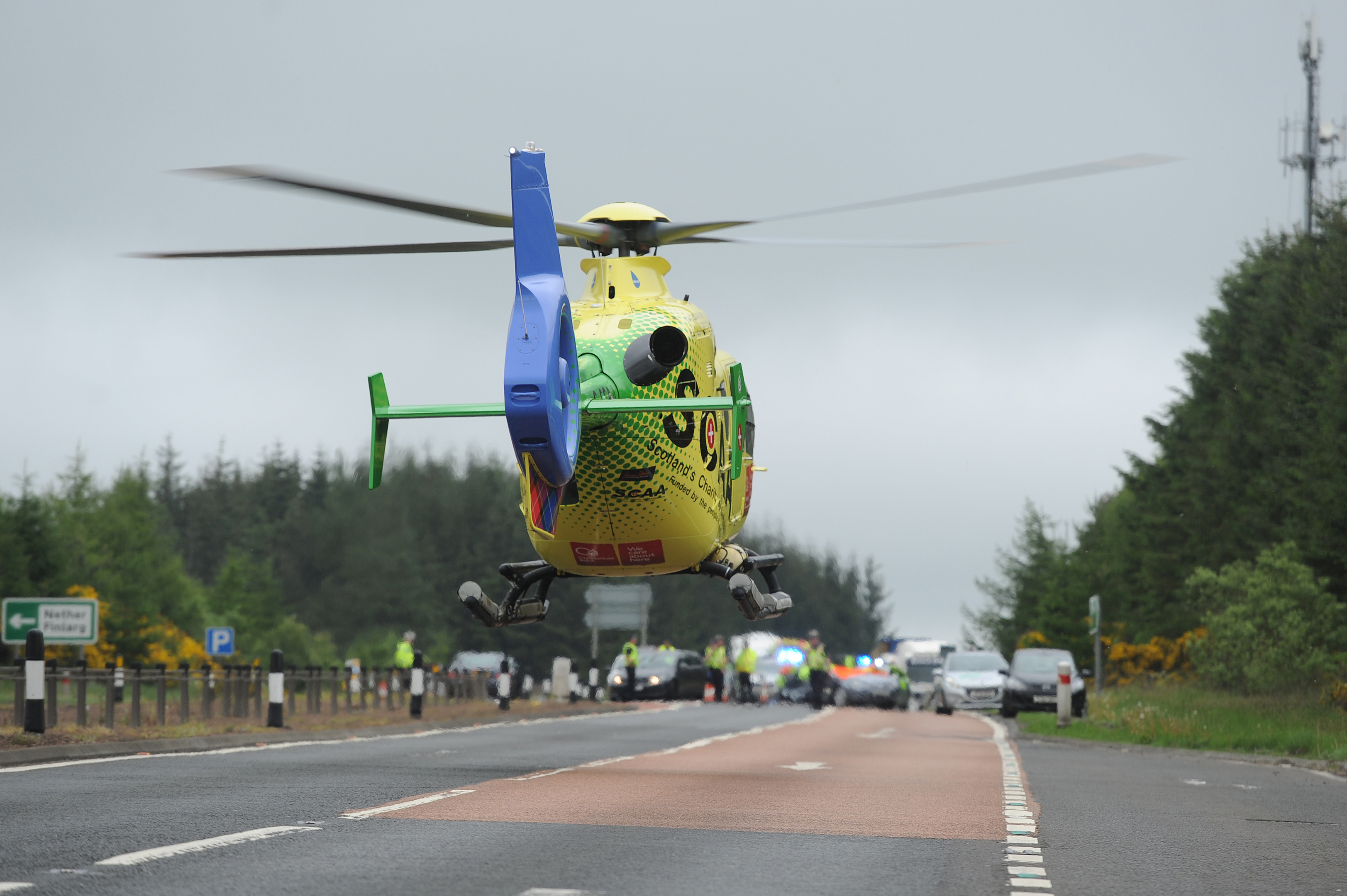 The Air Ambulance takes off from the scene.