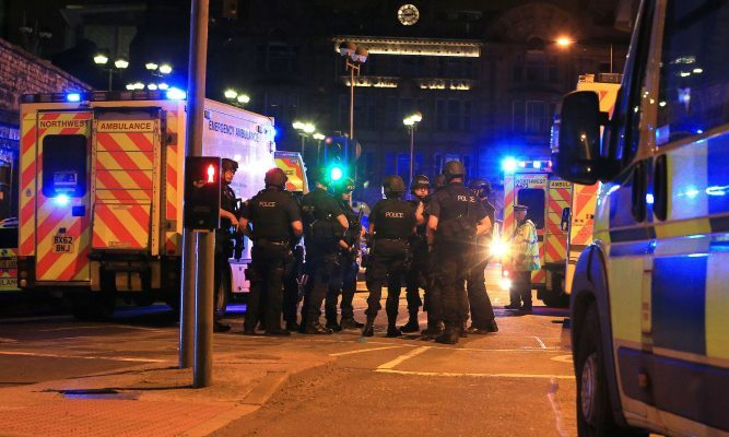 Armed police at Manchester Arena after the explosion following the Ariana Grande gig