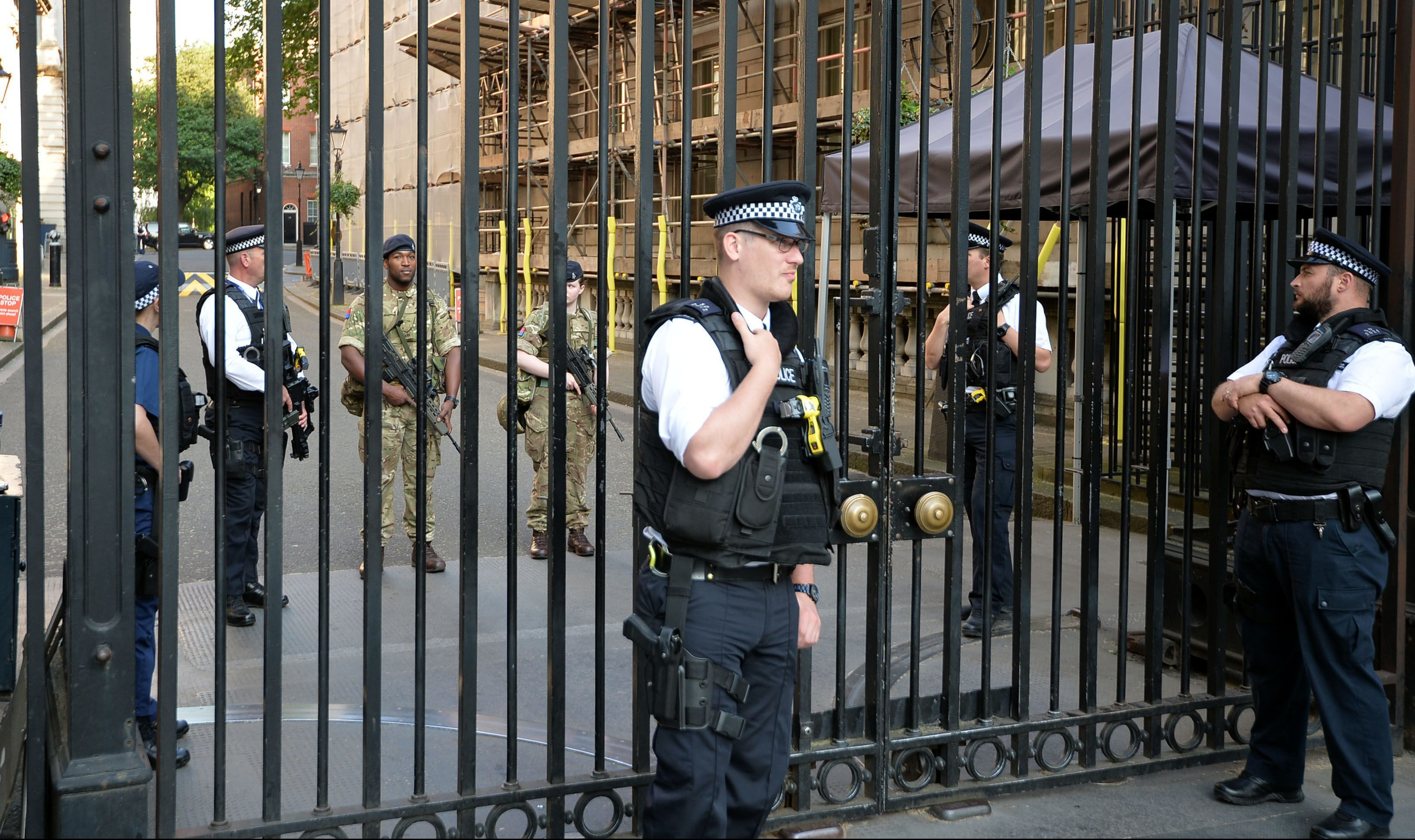 Soldiers join police in Downing Street, London, as armed troops have been deployed to guard 'key locations' under Operation Temperer