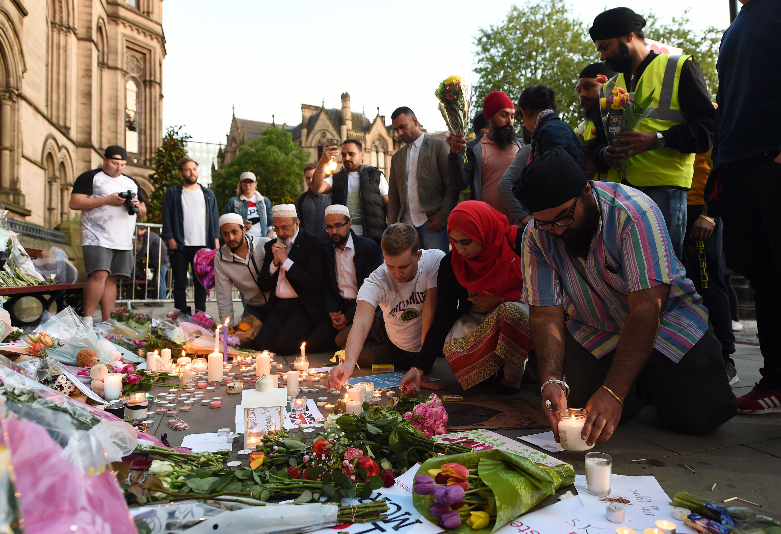 People leave tributes in Albert Square, Manchester