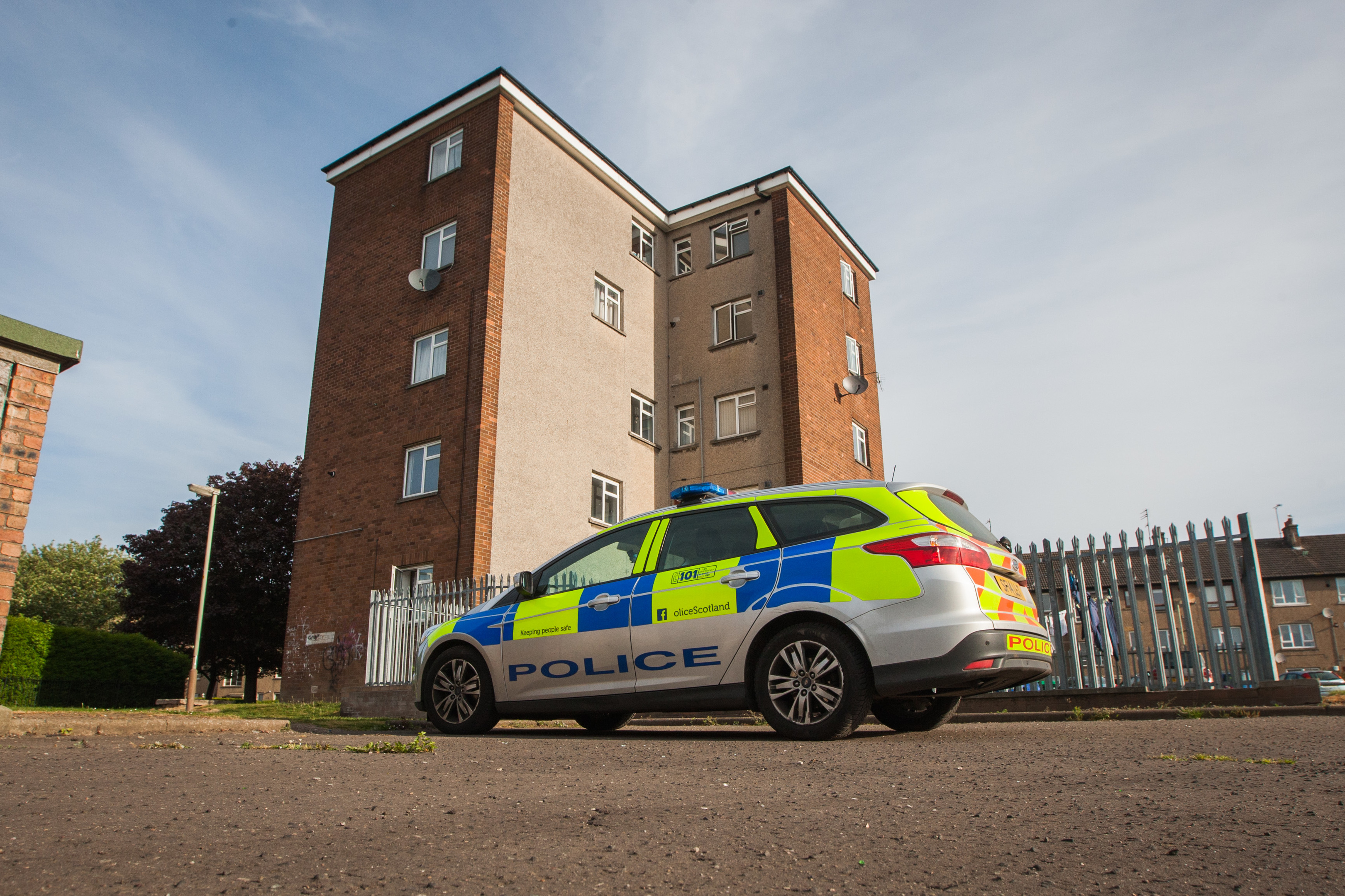 Police outside a block in Kemnay Gardens (library picture)