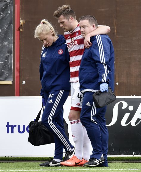 Michael Devlin is helped off the field by the Hamilton medical team
